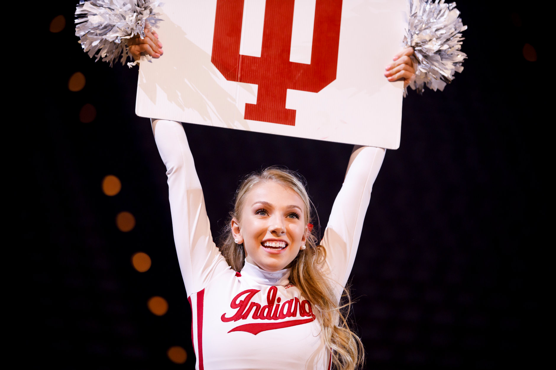 Indiana University cheerleaders teach students a cheer during the Traditions and Spirit of IU at Assembly Hall on Friday, Aug. 17, 2018. (James Brosher/IU Communications)