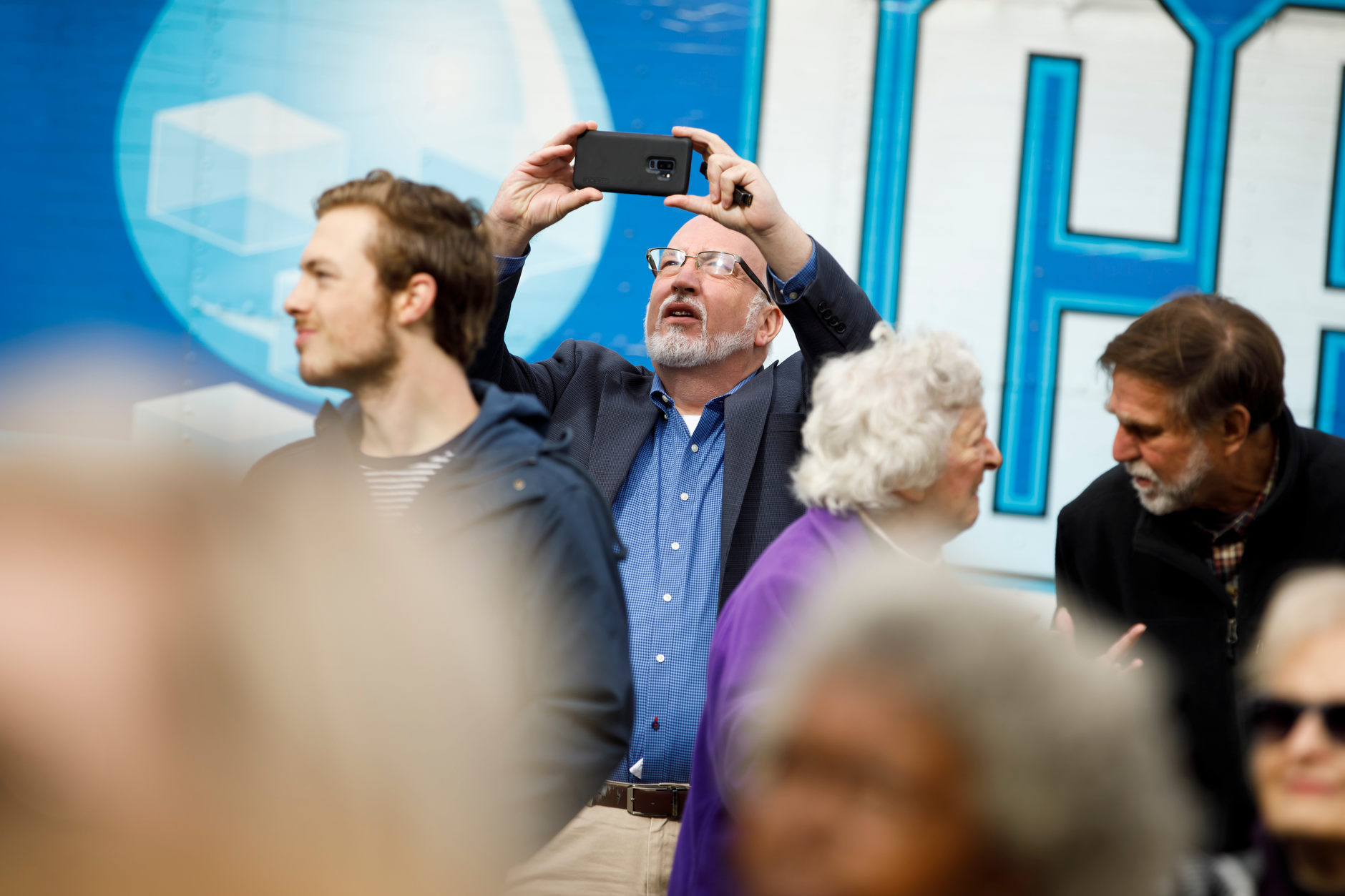 Jeffrey P. Weaver, campaign manager for Bernie Sanders' 2016 presidential campaign, takes a cell phone of the crowd before Sanders spoke at a rally for Liz Watson, the Democratic nominee for Indiana's 9th congressional district, in Dunn Meadow at Indiana University Bloomington on Friday, Oct. 19, 2018. (James Brosher/IU Communications)