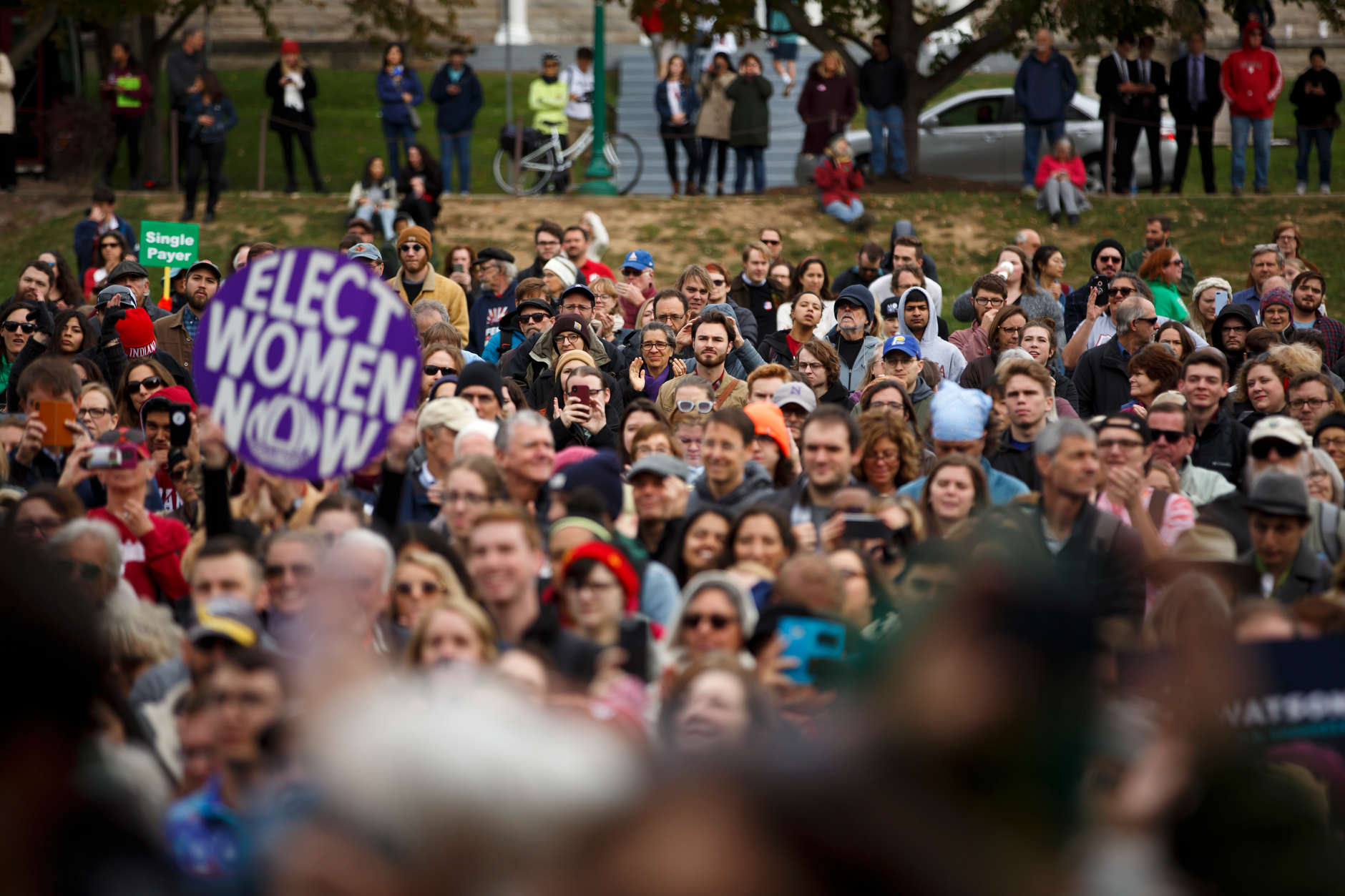 Supporters gather in Dunn Meadow to hear U.S. Sen. Bernie Sanders, I-VT, campaign for Liz Watson, the Democratic nominee for Indiana's 9th congressional district, at Indiana University Bloomington on Friday, Oct. 19, 2018. (James Brosher/IU Communications)