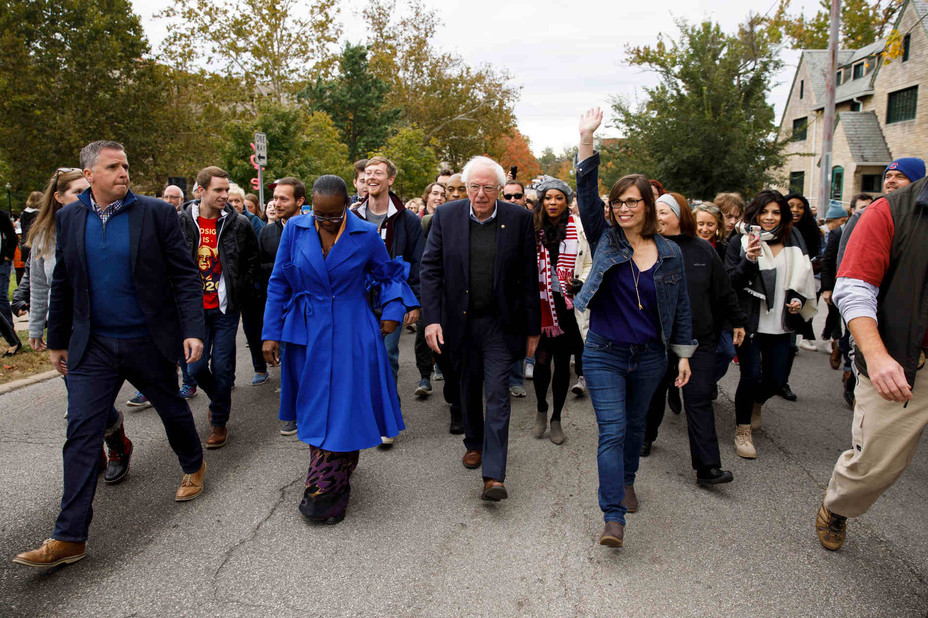U.S. Sen. Bernie Sanders, I-VT, center, leads a march to an early voting polling place after a rally for Liz Watson, right, the Democratic nominee for Indiana's 9th congressional district, in Dunn Meadow at Indiana University Bloomington on Friday, Oct. 19, 2018. (James Brosher/IU Communications)