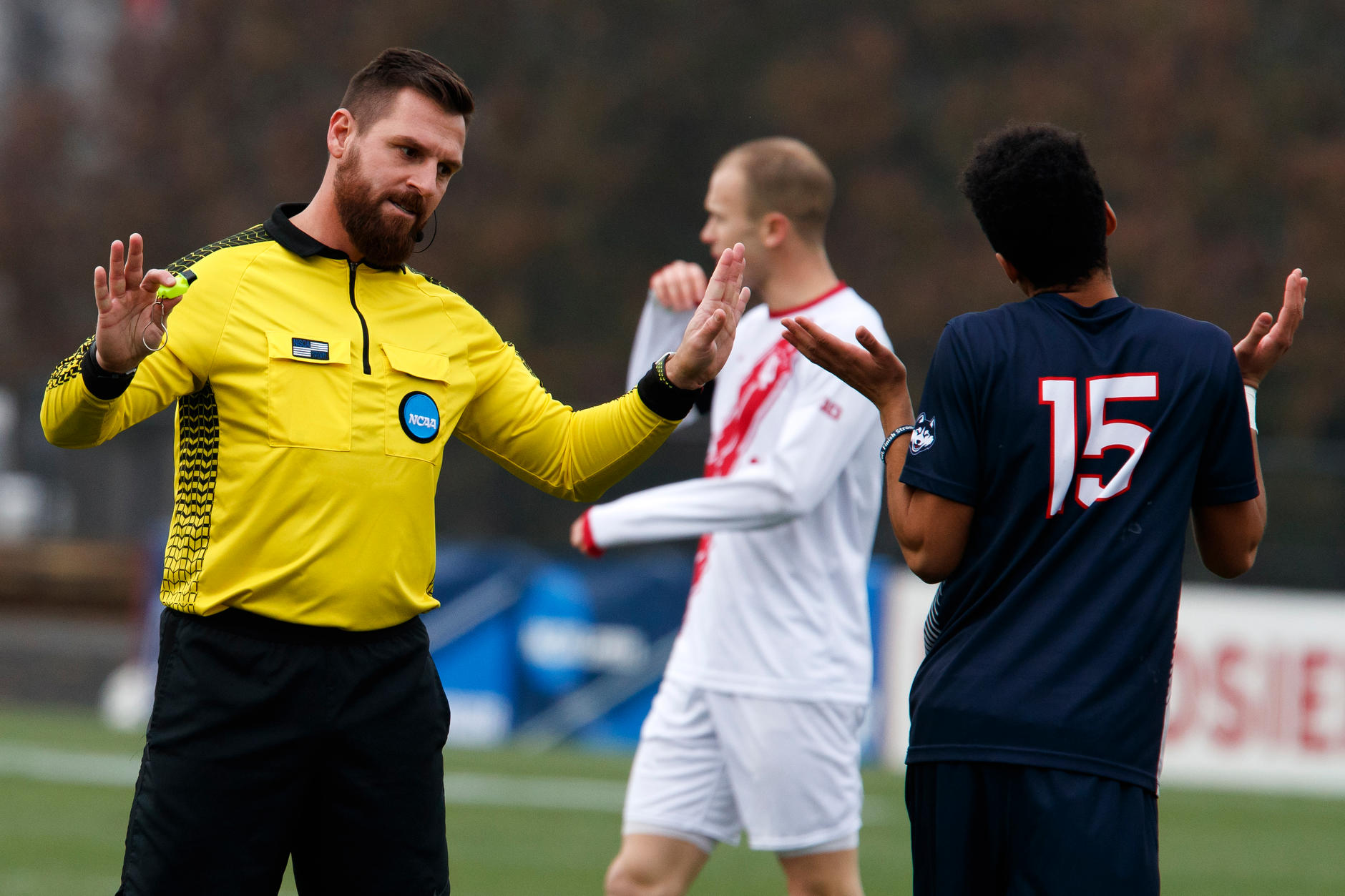 Referee Aaron Hernandez Connecticut's Cole Venner (15) during the second half of an NCAA men's soccer tournament match at Bill Armstrong Stadium in Bloomington, Ind. on Sunday, Nov. 18, 2018. IU won 4-0. (James Brosher for The Herald-Times)