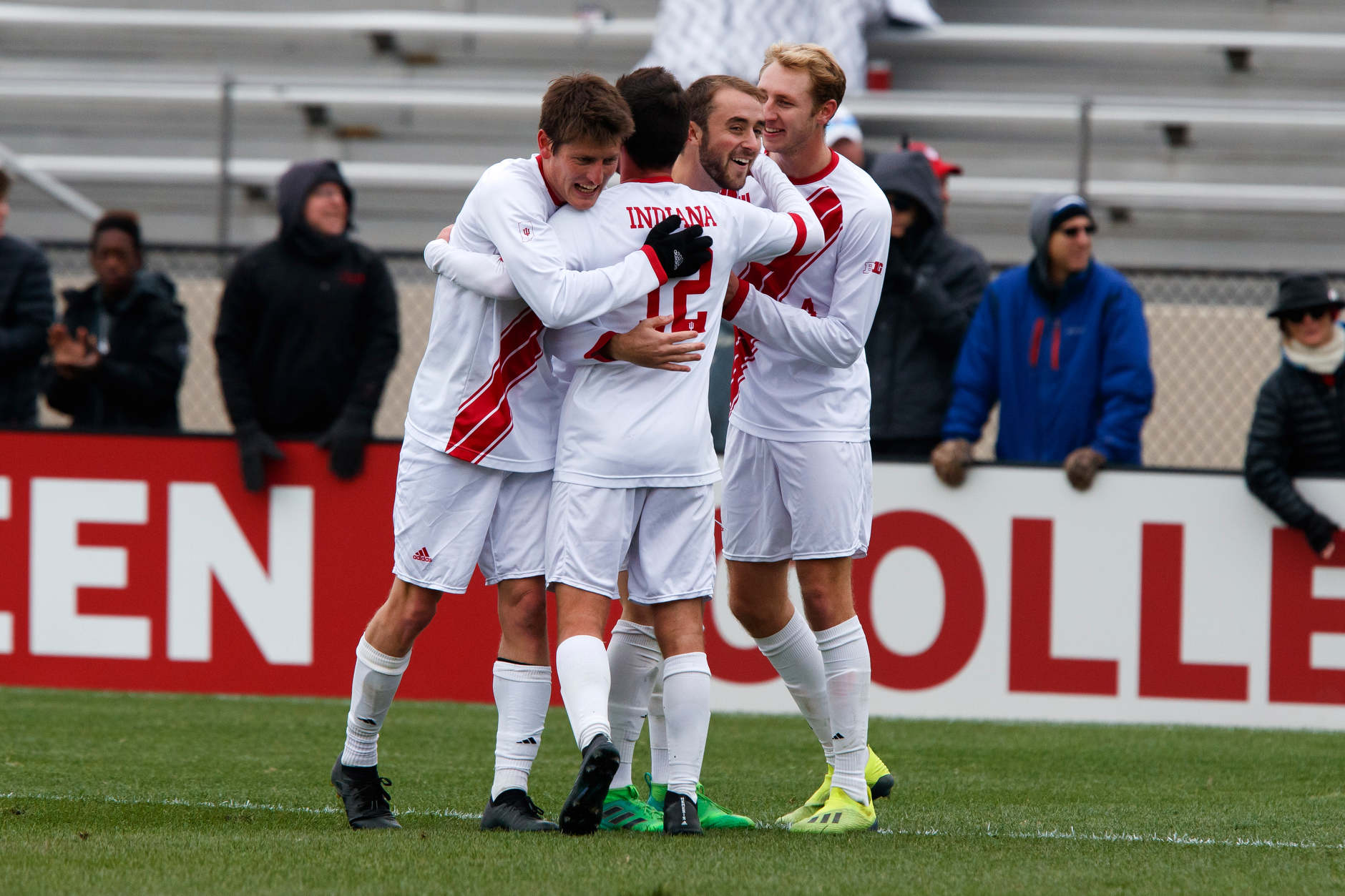 Indiana players celebrate a goal by Spencer Glass, center, during the second half of an NCAA men's soccer tournament match at Bill Armstrong Stadium in Bloomington, Ind. on Sunday, Nov. 18, 2018. IU won 4-0. (James Brosher for The Herald-Times)