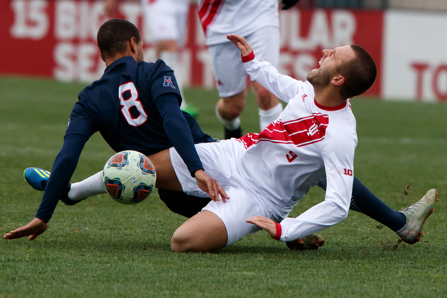 Connecticut's Felix Metzler (8) fouls Indiana's Thomas Warr (9) during the second half of an NCAA men's soccer tournament match at Bill Armstrong Stadium in Bloomington, Ind. on Sunday, Nov. 18, 2018. IU won 4-0. (James Brosher for The Herald-Times)