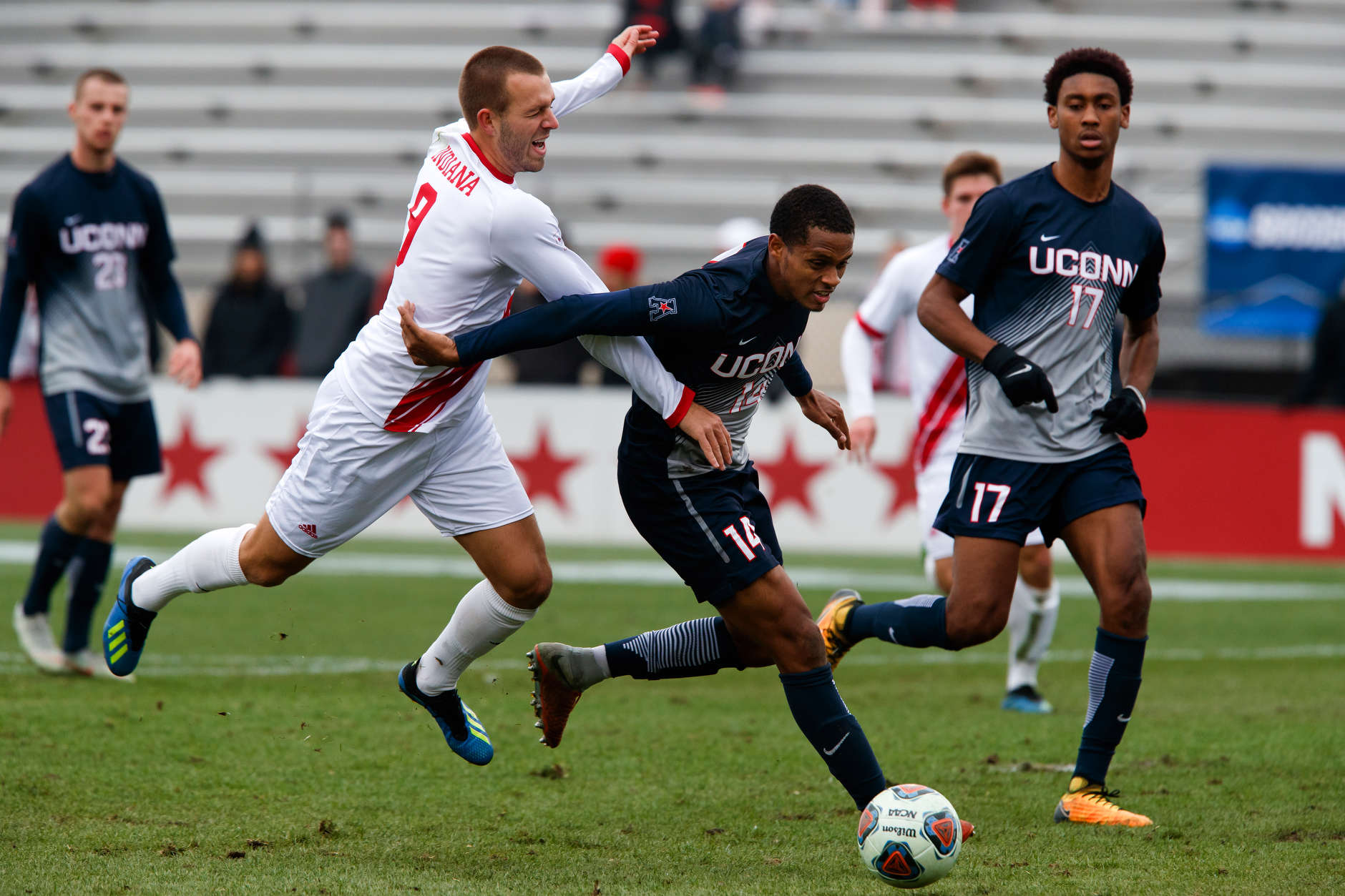 Indiana's Thomas Warr (9) and Connecticut's Munir Saleh (14) compete for the ball during the second half of an NCAA men's soccer tournament match at Bill Armstrong Stadium in Bloomington, Ind. on Sunday, Nov. 18, 2018. IU won 4-0. (James Brosher for The Herald-Times)