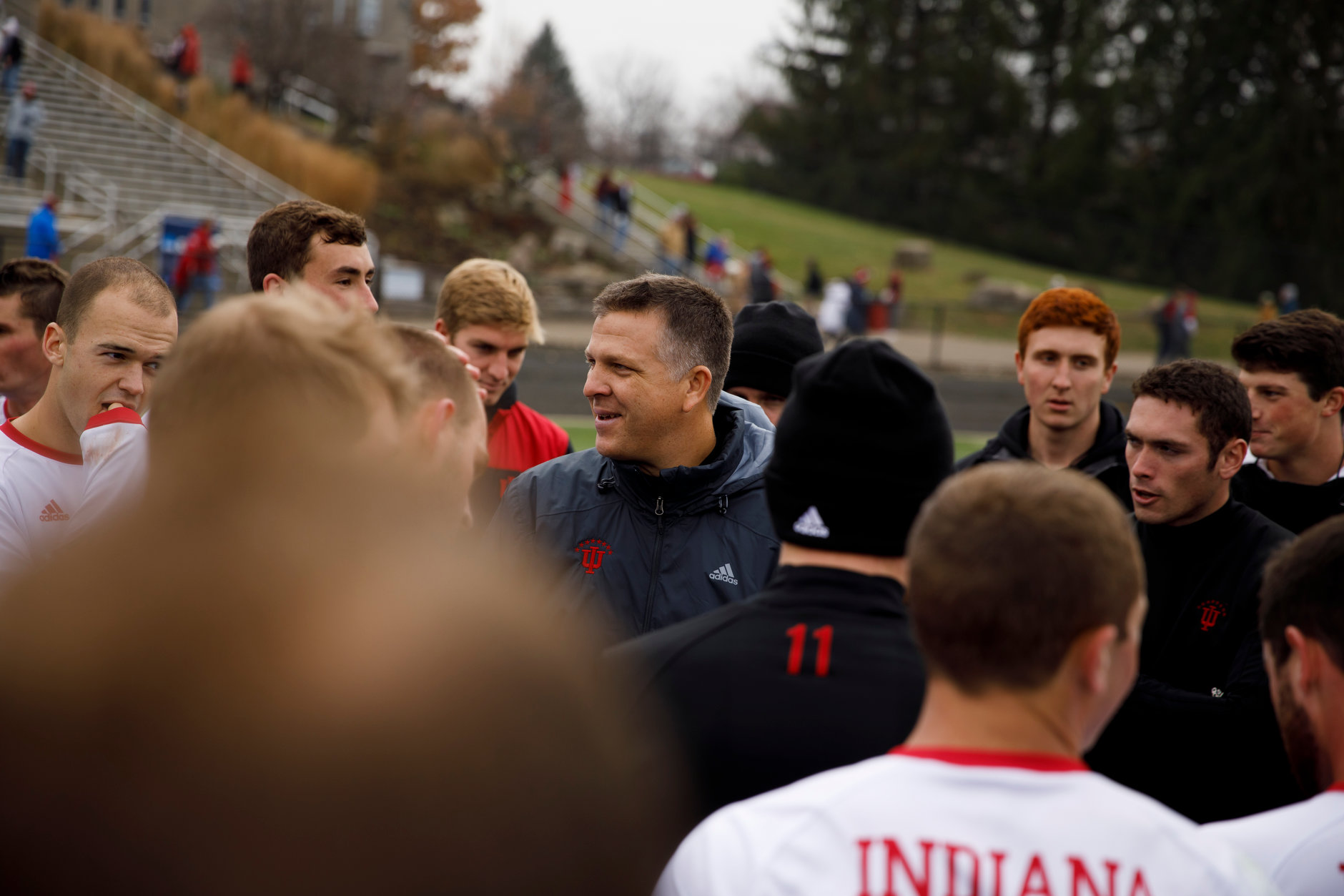 Indiana head coach Todd Yeagley speaks with his players following a 4-0 win against Connecticut in an NCAA men's soccer tournament match at Bill Armstrong Stadium in Bloomington, Ind. on Sunday, Nov. 18, 2018. (James Brosher for The Herald-Times)