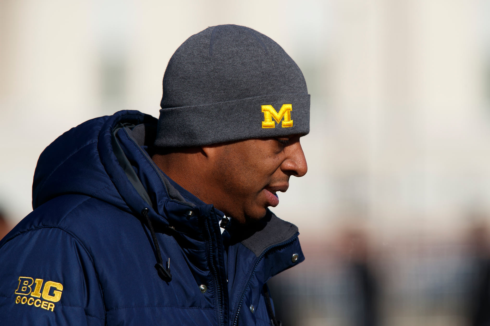 Michigan coach Chaka Daley stands on the sidelines before the Big Ten Men's Soccer Tournament championship game against Indiana at Grand Park in Westfield, Indiana on Sunday, Nov. 11, 2018. (Photo by James Brosher)