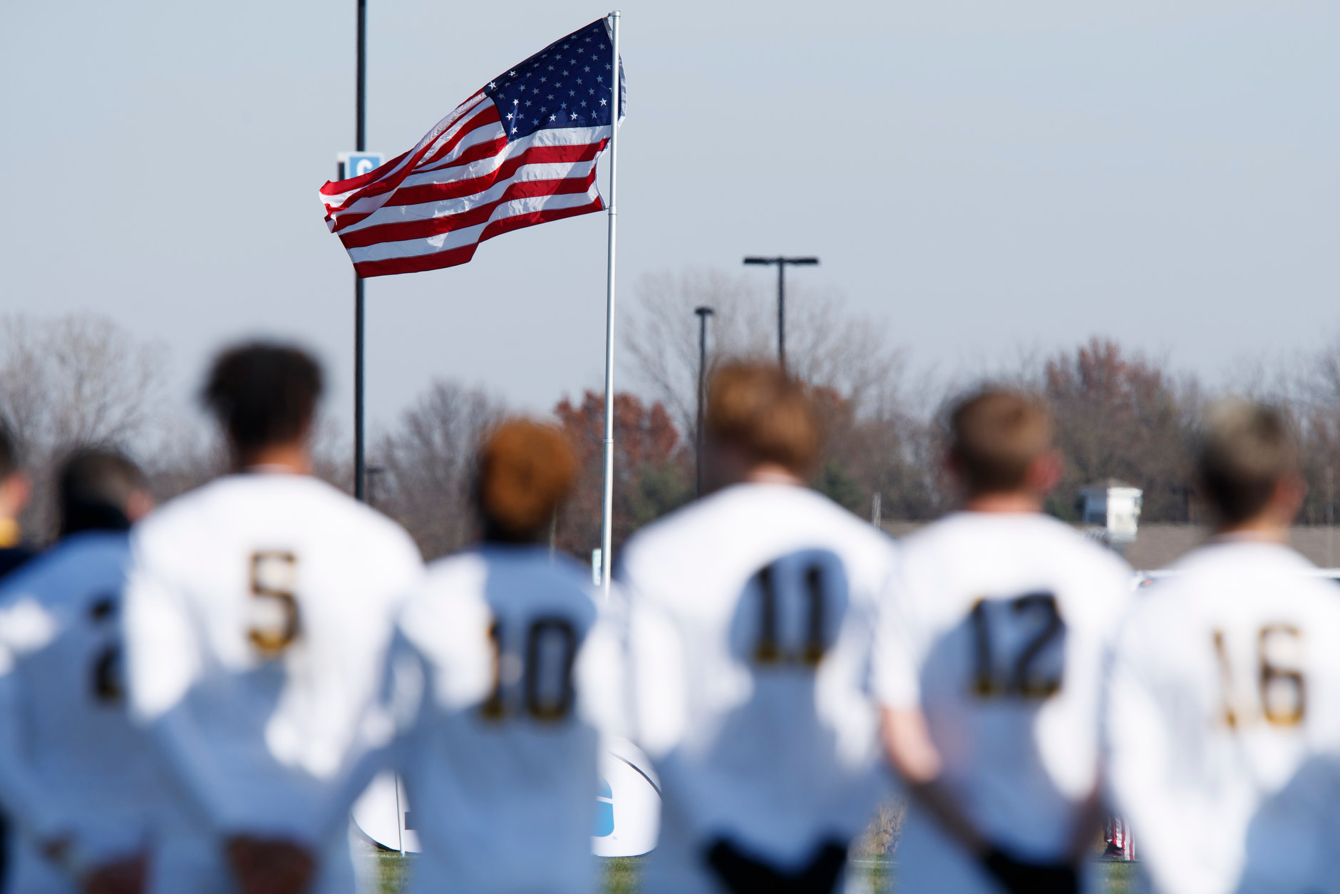 Michigan players stand for the singing of the National Anthem before the Big Ten Men's Soccer Tournament championship game against Indiana at Grand Park in Westfield, Indiana on Sunday, Nov. 11, 2018. (Photo by James Brosher)