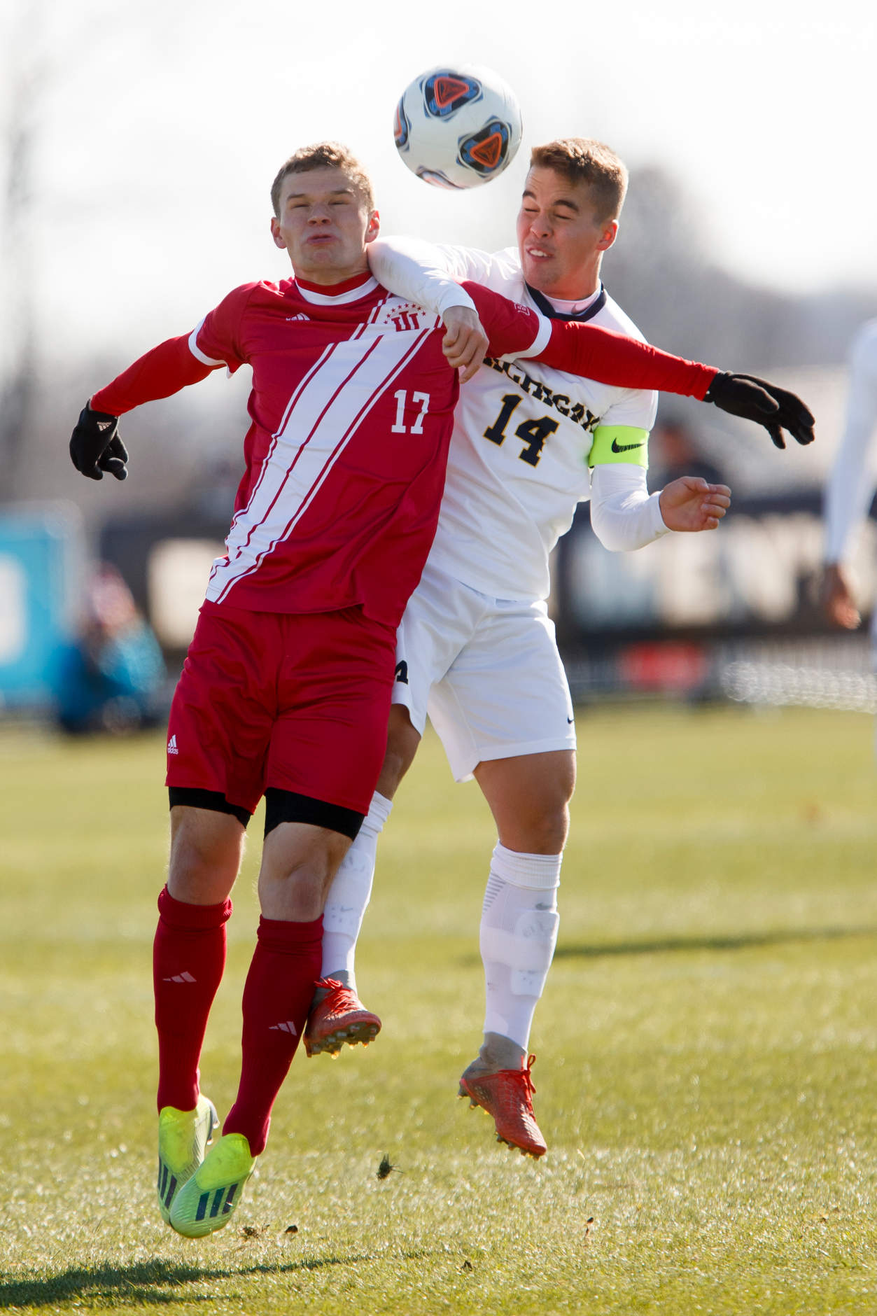 Michigan's Robbie Mertz (14) and Indiana's Jeremiah Gutjahr (17) compete for a header during the Big Ten Men's Soccer Tournament championship game at Grand Park in Westfield, Indiana on Sunday, Nov. 11, 2018. (Photo by James Brosher)