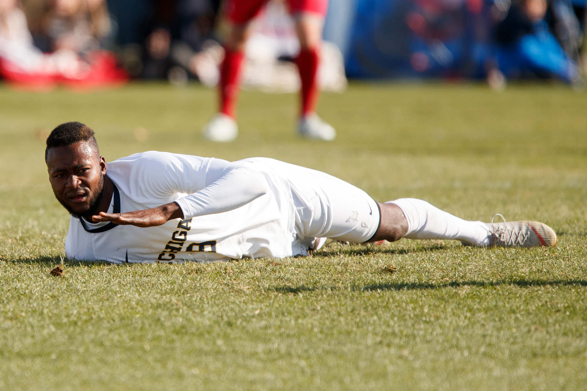Michigan's Mohammed Zakyi (9) reacts after missing a cross during the Big Ten Men's Soccer Tournament championship game against Indiana at Grand Park in Westfield, Indiana on Sunday, Nov. 11, 2018. (Photo by James Brosher)
