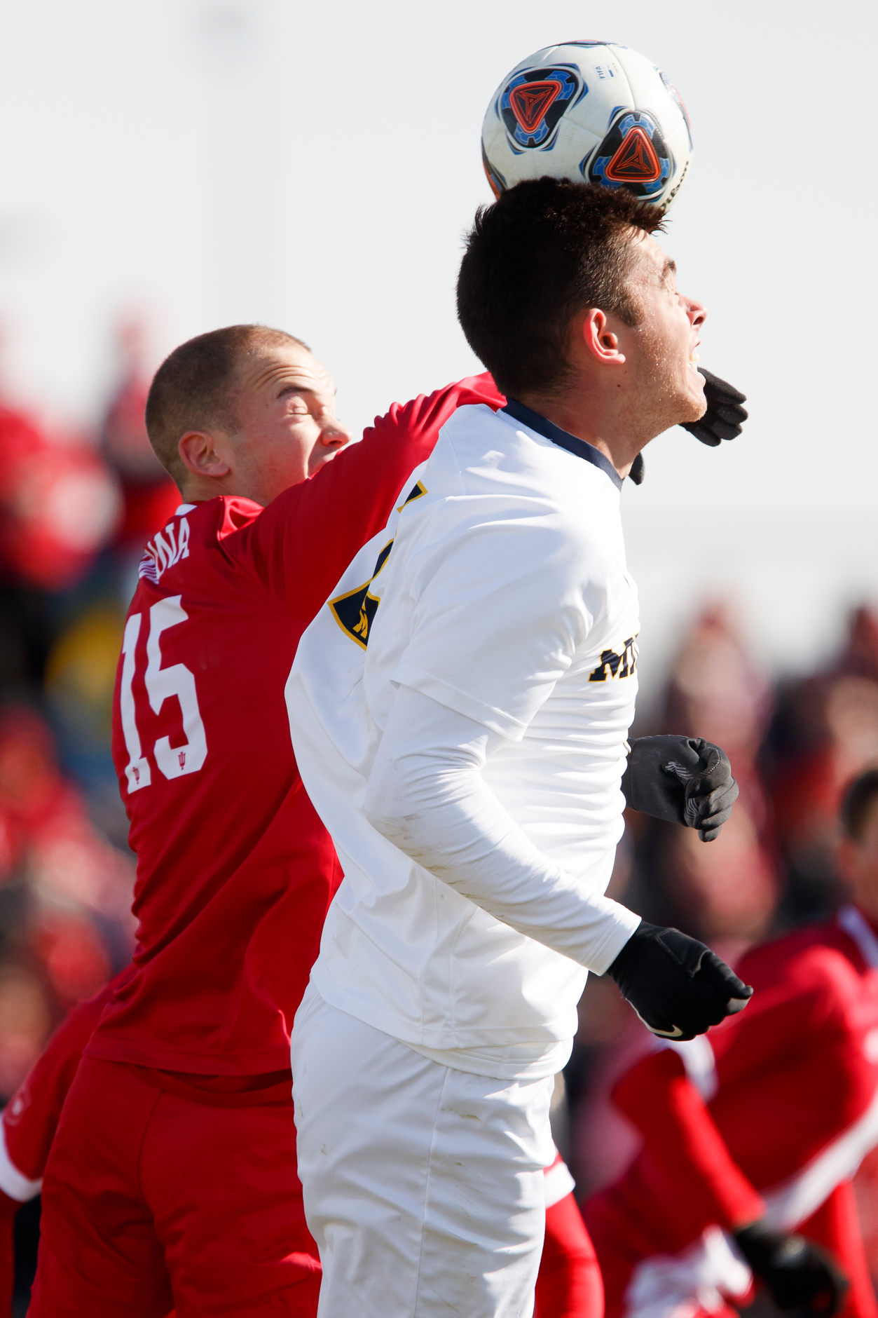 Michigan's Jackson Ragen (25) heads the ball in front of Indiana's Andrew Gutman (15) during the Big Ten Men's Soccer Tournament championship game at Grand Park in Westfield, Indiana on Sunday, Nov. 11, 2018. (Photo by James Brosher)