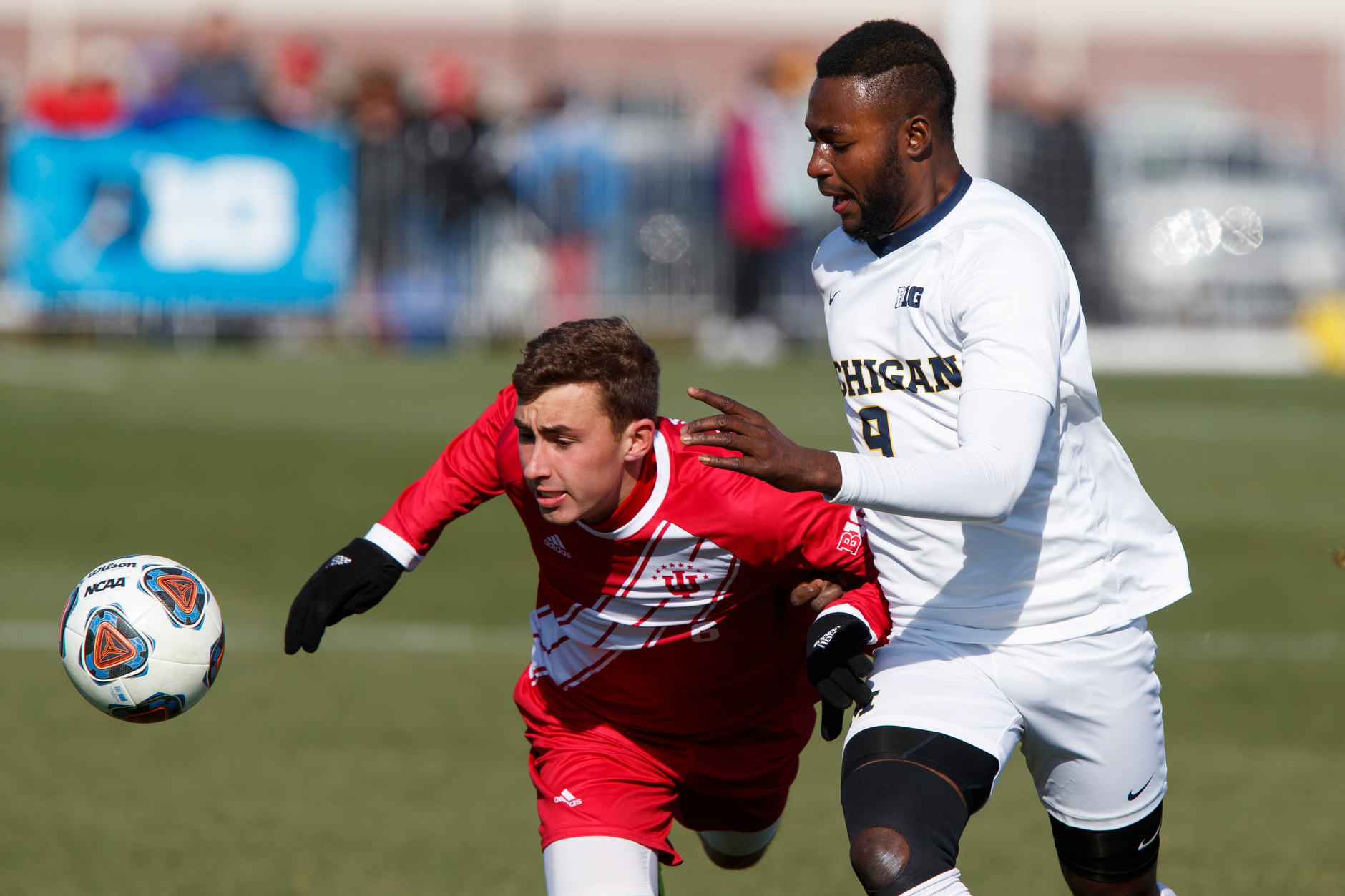 Michigan's Mohammed Zakyi (9) and Indiana's Jack Maher (6) play the ball during the Big Ten Men's Soccer Tournament championship game at Grand Park in Westfield, Indiana on Sunday, Nov. 11, 2018. (Photo by James Brosher)