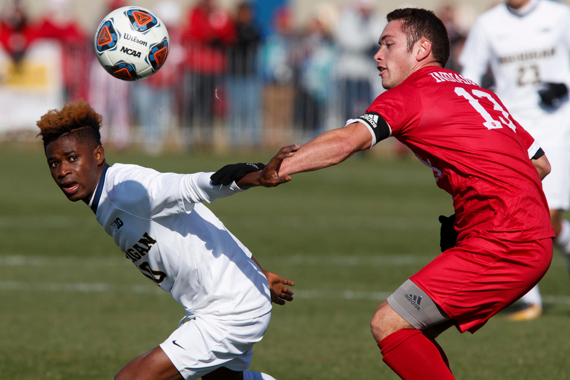 Michigan's Umar Farouk Osman (10) and Indiana's Francesco Moore (13) compete for the ball during the Big Ten Men's Soccer Tournament championship game at Grand Park in Westfield, Indiana on Sunday, Nov. 11, 2018. (Photo by James Brosher)