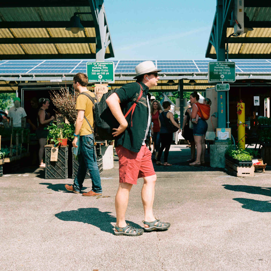 Patrons walk through the Bloomington Farmer's Market on Saturday, June 2, 2018. (Photo by James Brosher)