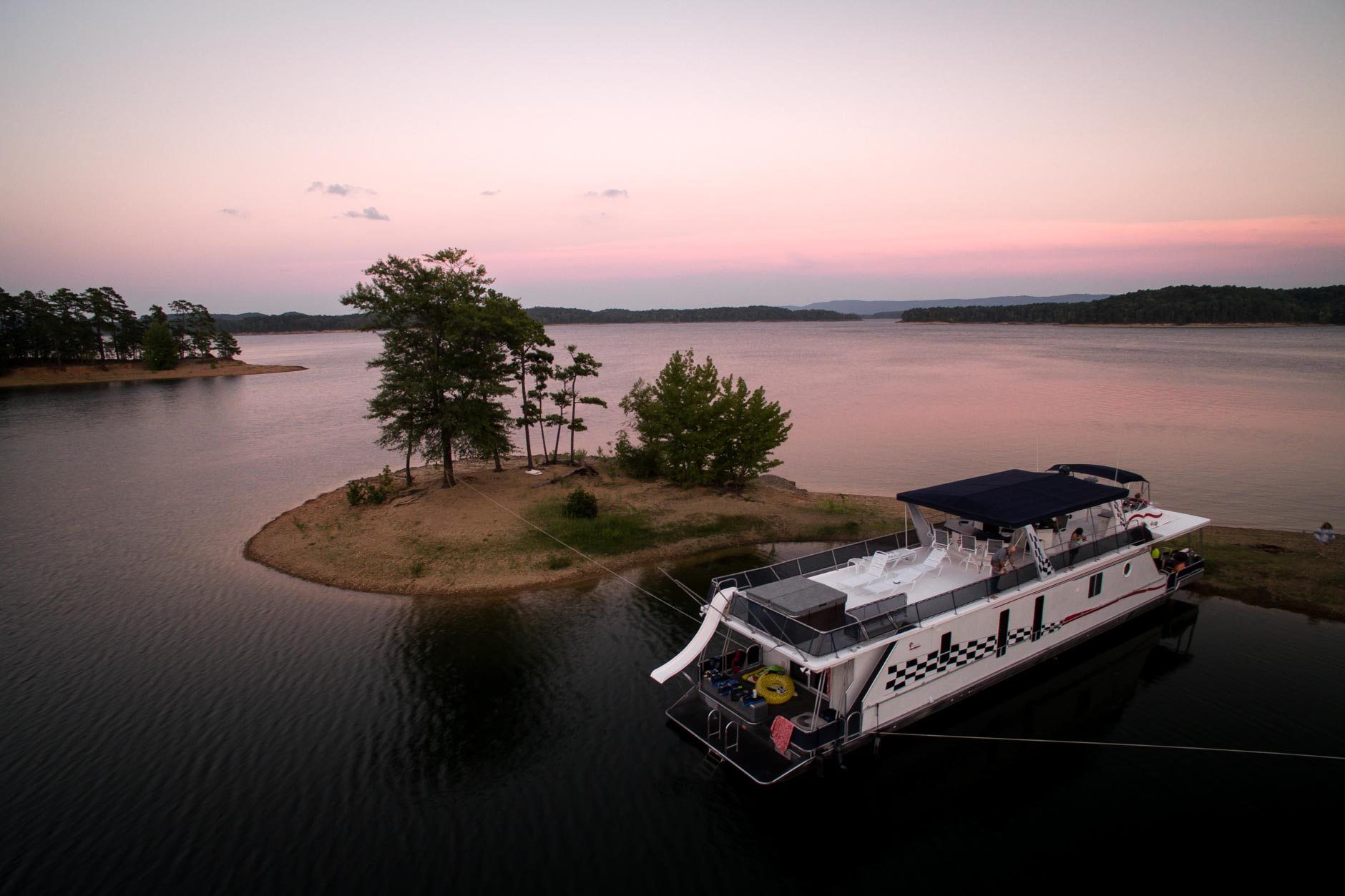 A DreamChaser boat is docked in a cove on Lake Ouachita, Arkansas on Monday, Aug. 20, 2018. (Photo by James Brosher)