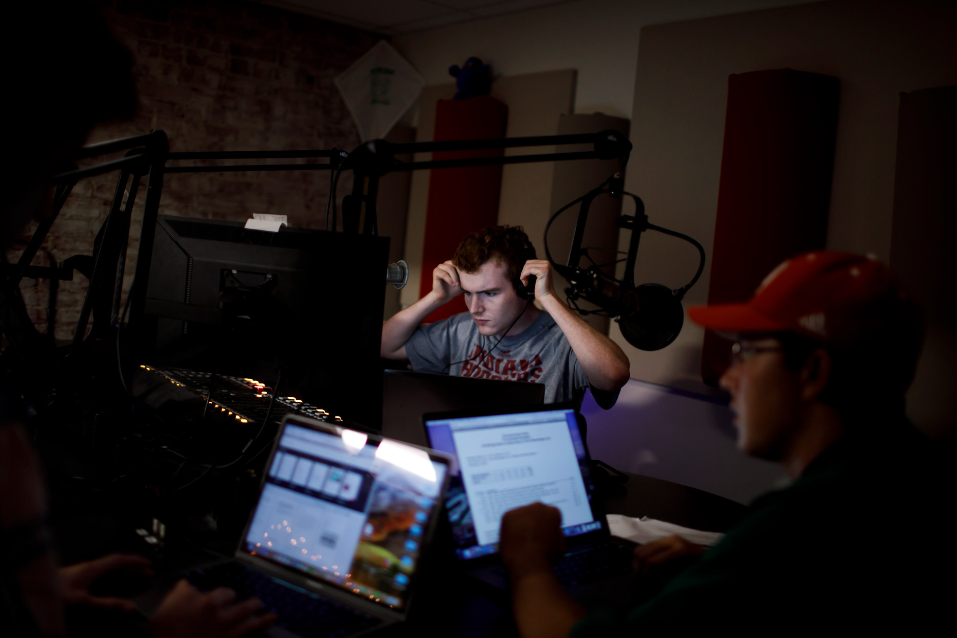 Students prepare to broadcast a sports program in the WIUX studios in Franklin Hall on Tuesday, Sept. 25, 2018.