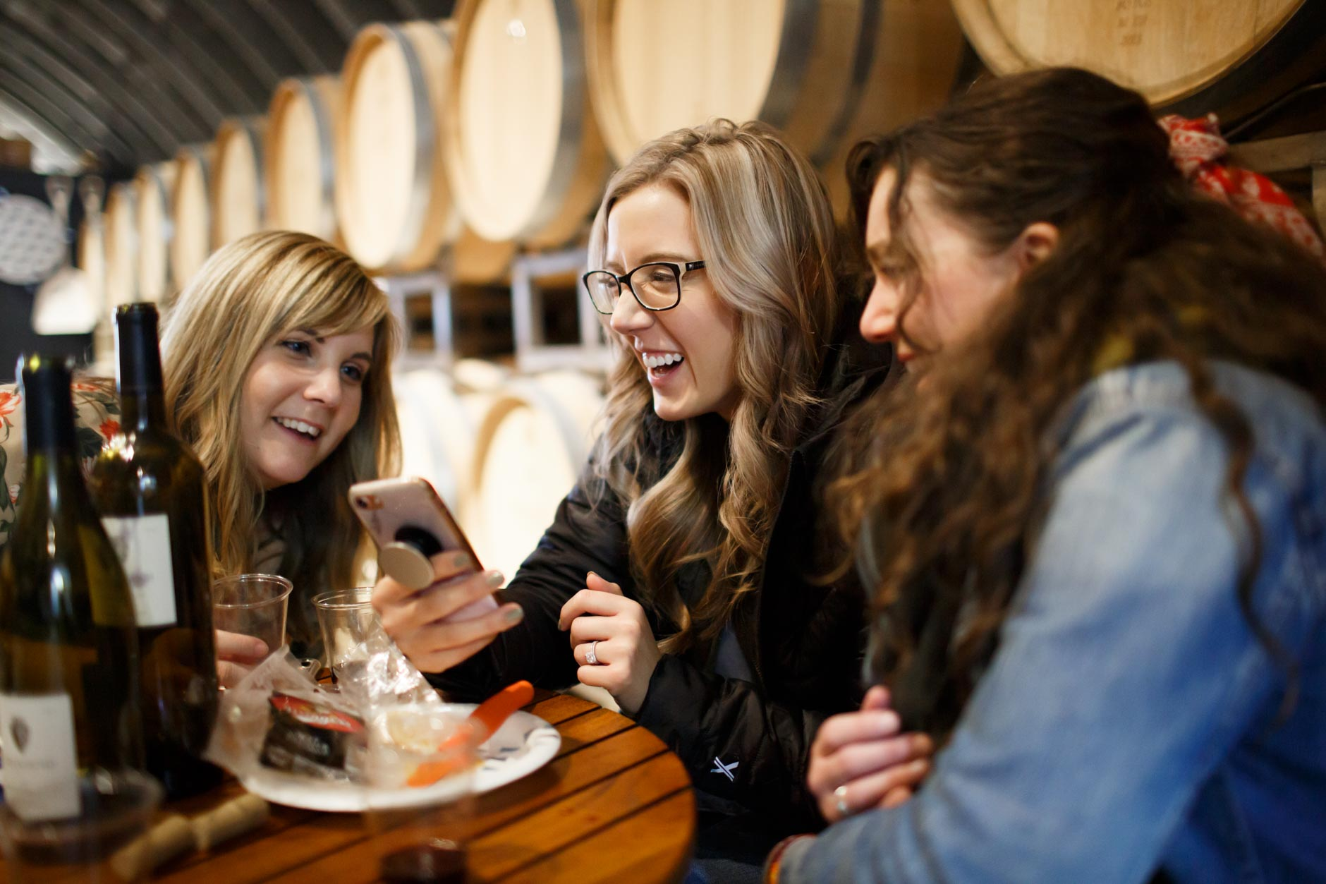 Barbara Brosher, left, Katie Carragher and Emily Mieure laugh at Oliver Winery in Bloomington, Indiana on Sunday, Jan. 27, 2019. (Photo by James Brosher)