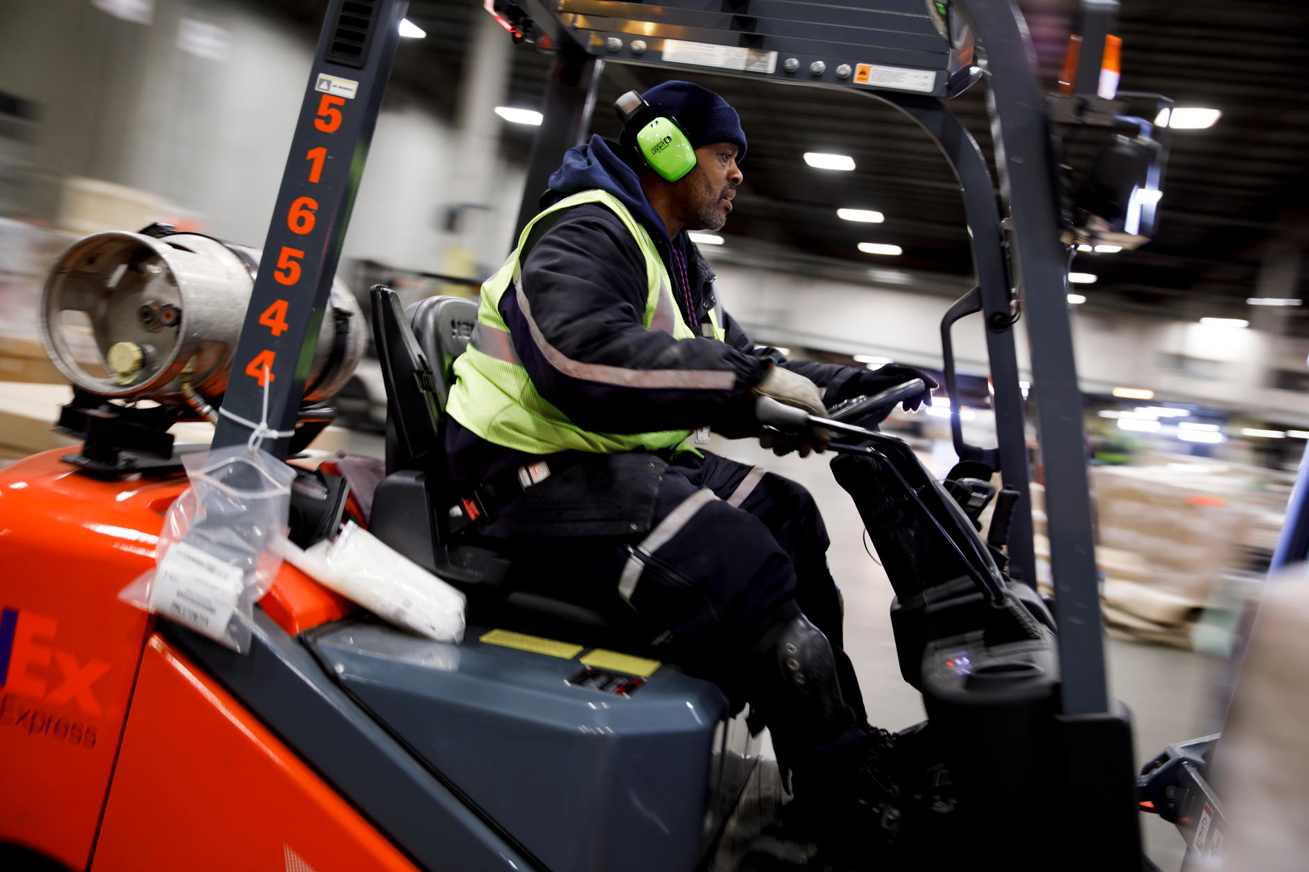 James Wilson, a FedEx material handler, uses a forklift to load a pallet of packages for shipment at the FedEx Express Hub in Indianapolis in the early morning hours of Wednesday, Feb. 27, 2019. The jobless rate in the United States is near the lowest level since the 1960s, but gains are not being distributed evenly. (James Brosher for The Wall Street Journal)