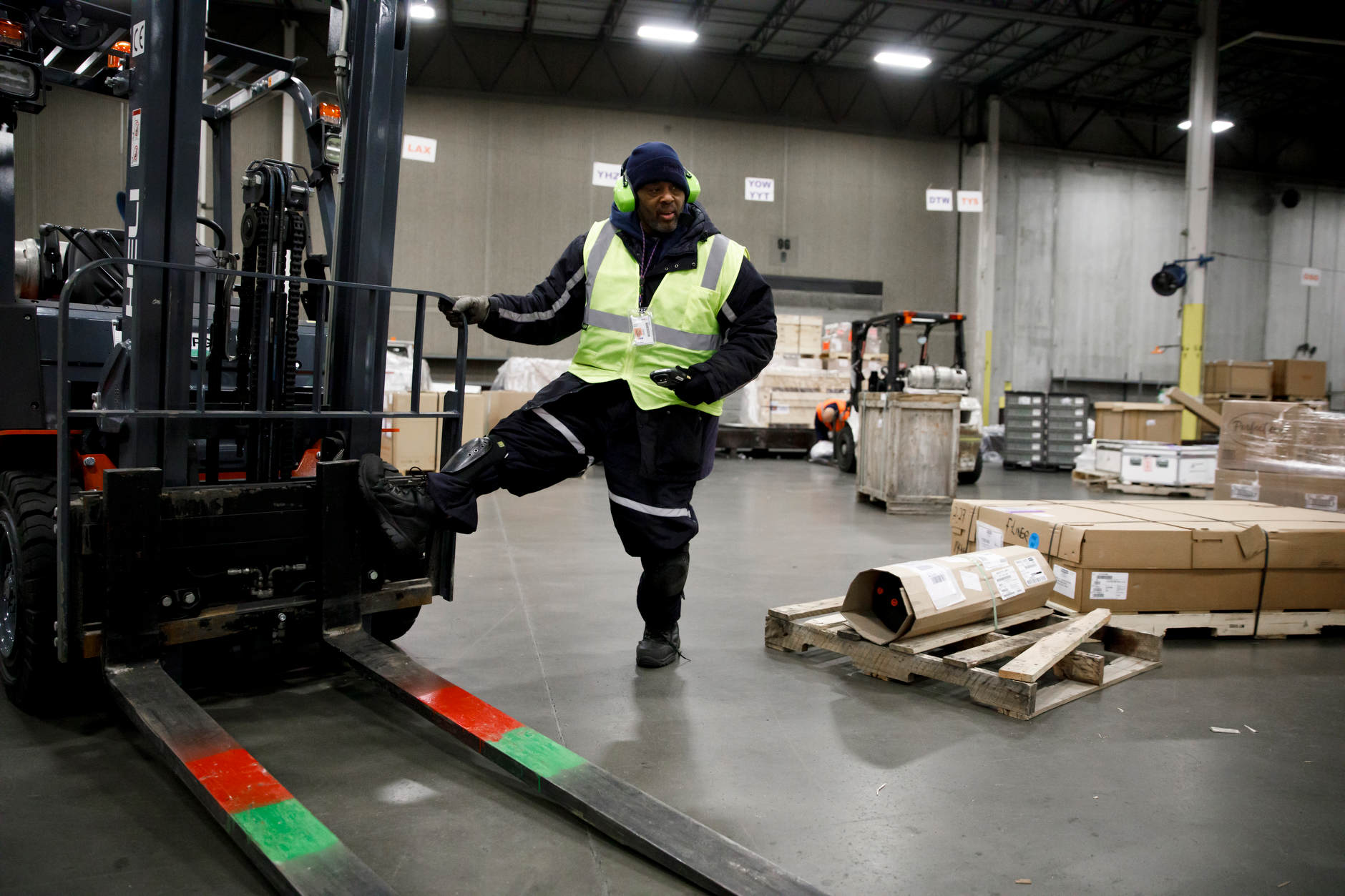 James Wilson, a FedEx material handler, uses a forklift to load a pallet of packages for shipment at the FedEx Express Hub in Indianapolis in the early morning hours of Wednesday, Feb. 27, 2019. (James Brosher for The Wall Street Journal)