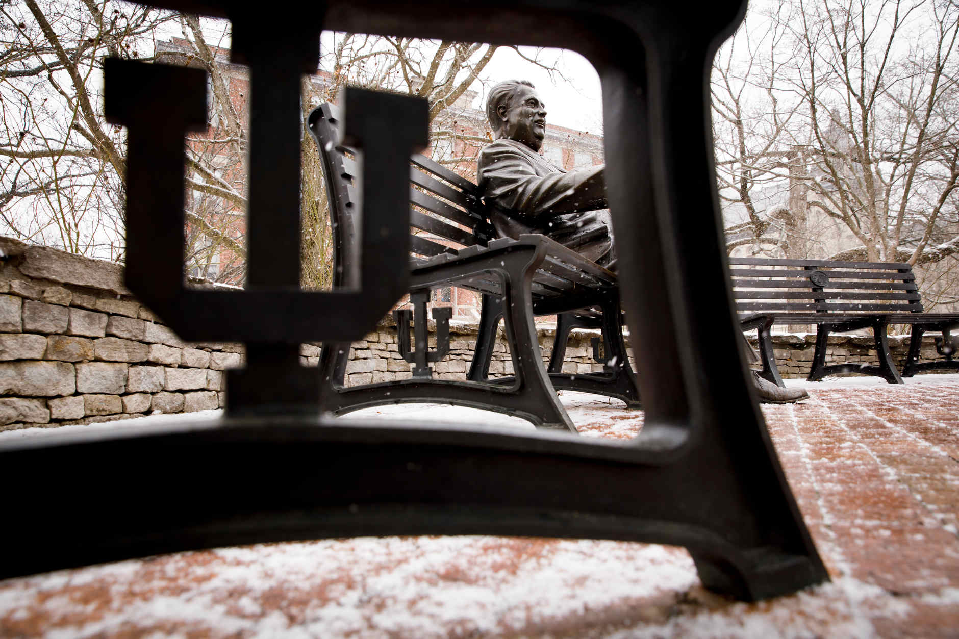 Snow falls near a sculpture of Herman B Wells in the Old Crescent at IU Bloomington on Thursday, March 7, 2019. (James Brosher/Indiana University)