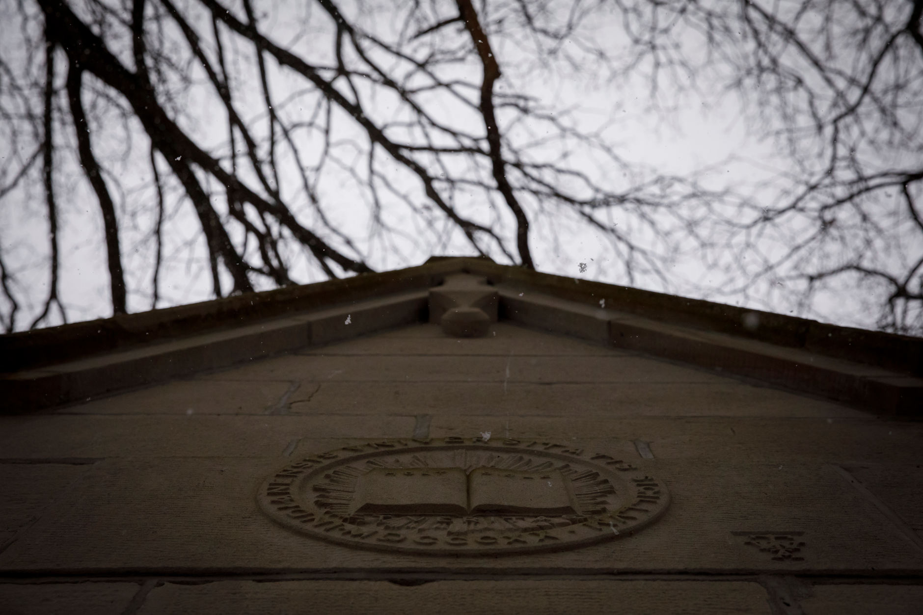 Snowflakes fall from the roof of the Rose Well House in the Old Crescent at IU Bloomington on Thursday, March 7, 2019. (James Brosher/Indiana University)