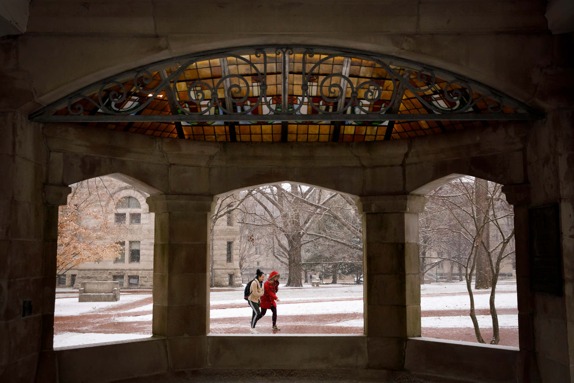 Students traverse the Old Crescent near the Rose Well House at IU Bloomington on Thursday, March 7, 2019. (James Brosher/Indiana University)