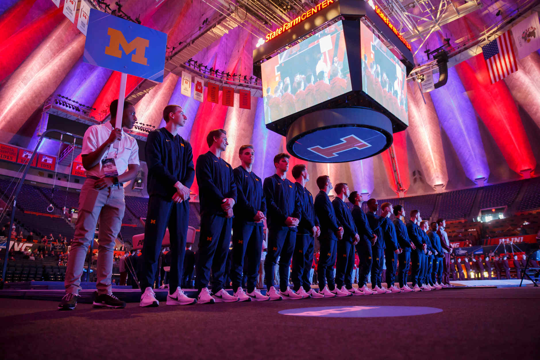 Michigan gymnasts stand for the National Anthem at the NCAA Men's Gymnastics Championships on Friday, April 19, 2019, at the State Farm Center in Champaign, Illinois. (Photo by James Brosher)