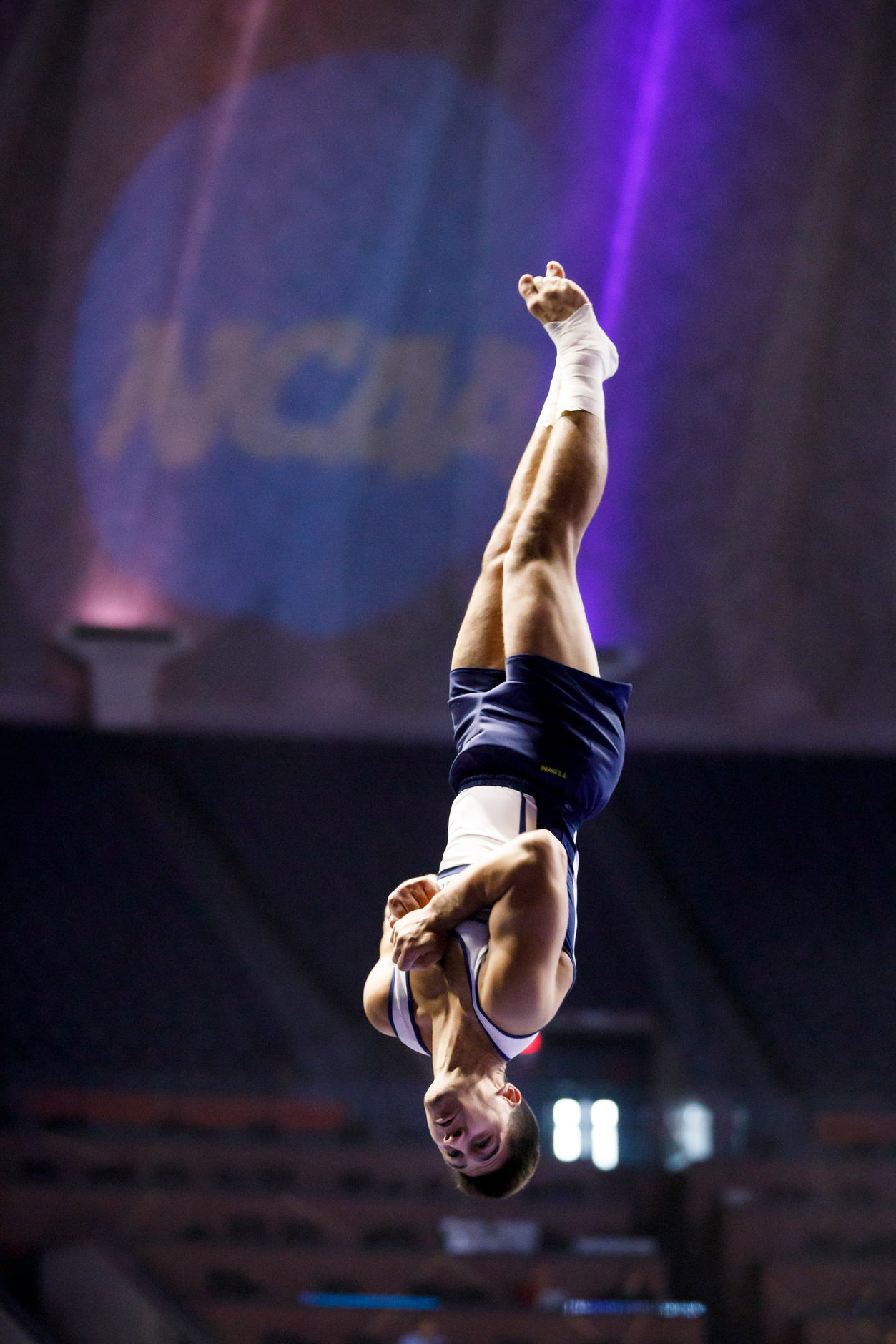 Michigan's Nick Guy competes on the vault at the NCAA Men's Gymnastics Championships on Friday, April 19, 2019, at the State Farm Center in Champaign, Illinois. (Photo by James Brosher)