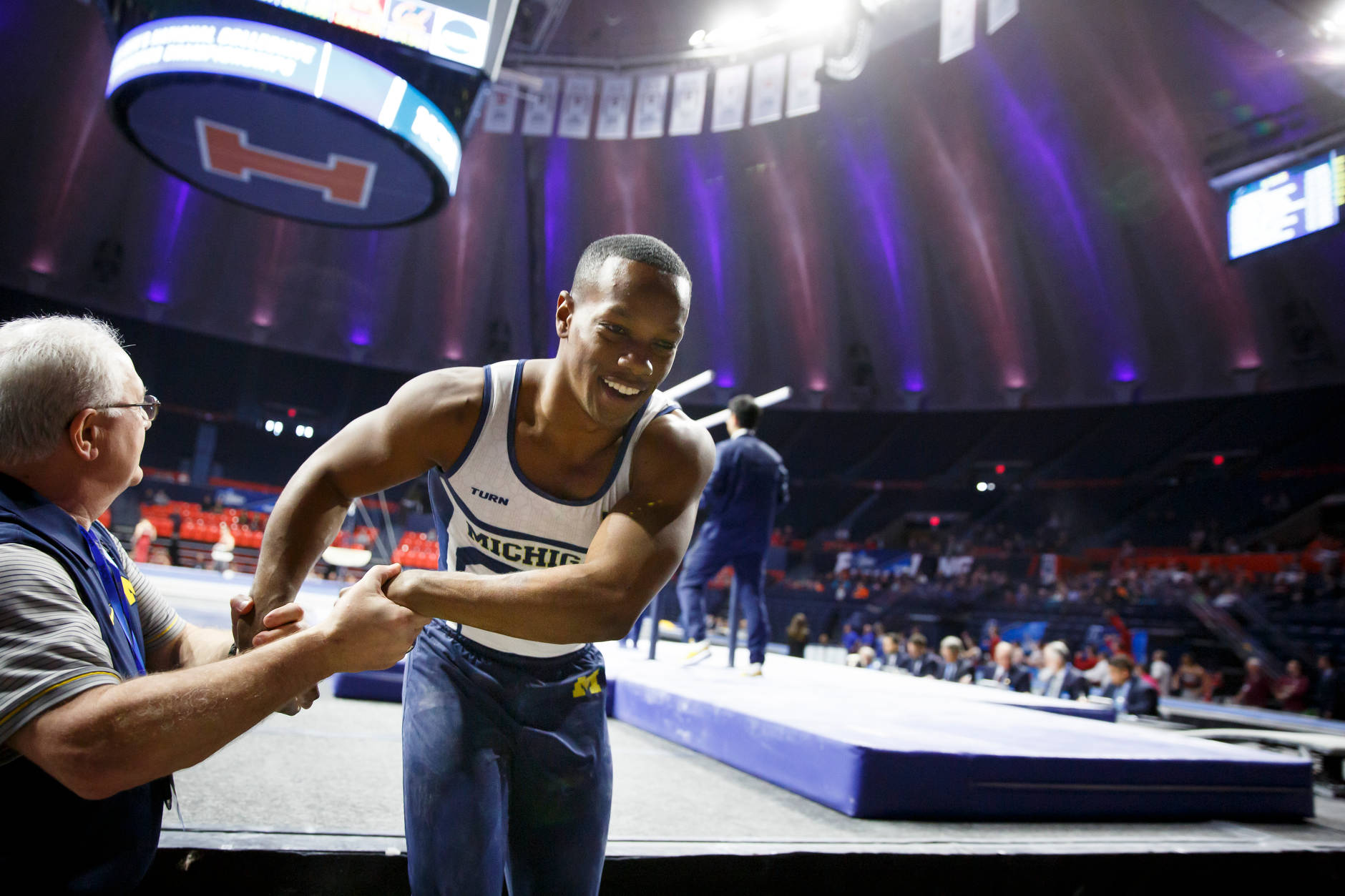 Michigan's Emyre Cole reacts after competing on parallel bars at the NCAA Men's Gymnastics Championships on Friday, April 19, 2019, at the State Farm Center in Champaign, Illinois. (Photo by James Brosher)