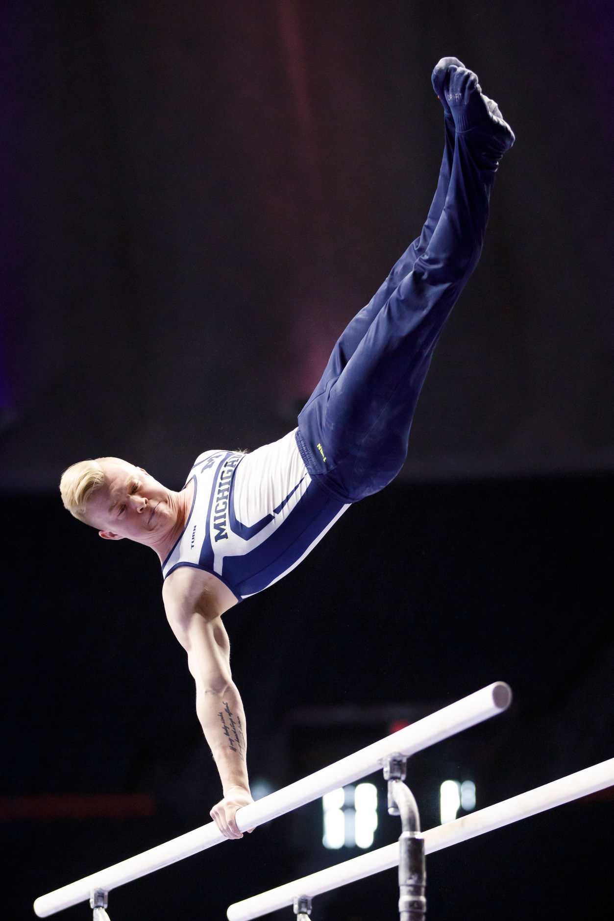 Michigan's Cameron Bock competes on parallel bars at the NCAA Men's Gymnastics Championships on Friday, April 19, 2019, at the State Farm Center in Champaign, Illinois. (Photo by James Brosher)