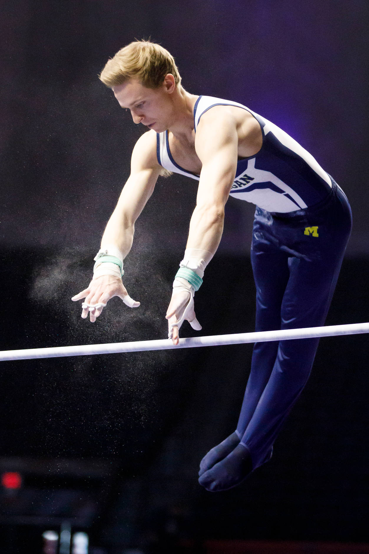 Michigan's Alec Krystek competes on the high bar at the NCAA Men's Gymnastics Championships on Friday, April 19, 2019, at the State Farm Center in Champaign, Illinois. (Photo by James Brosher)