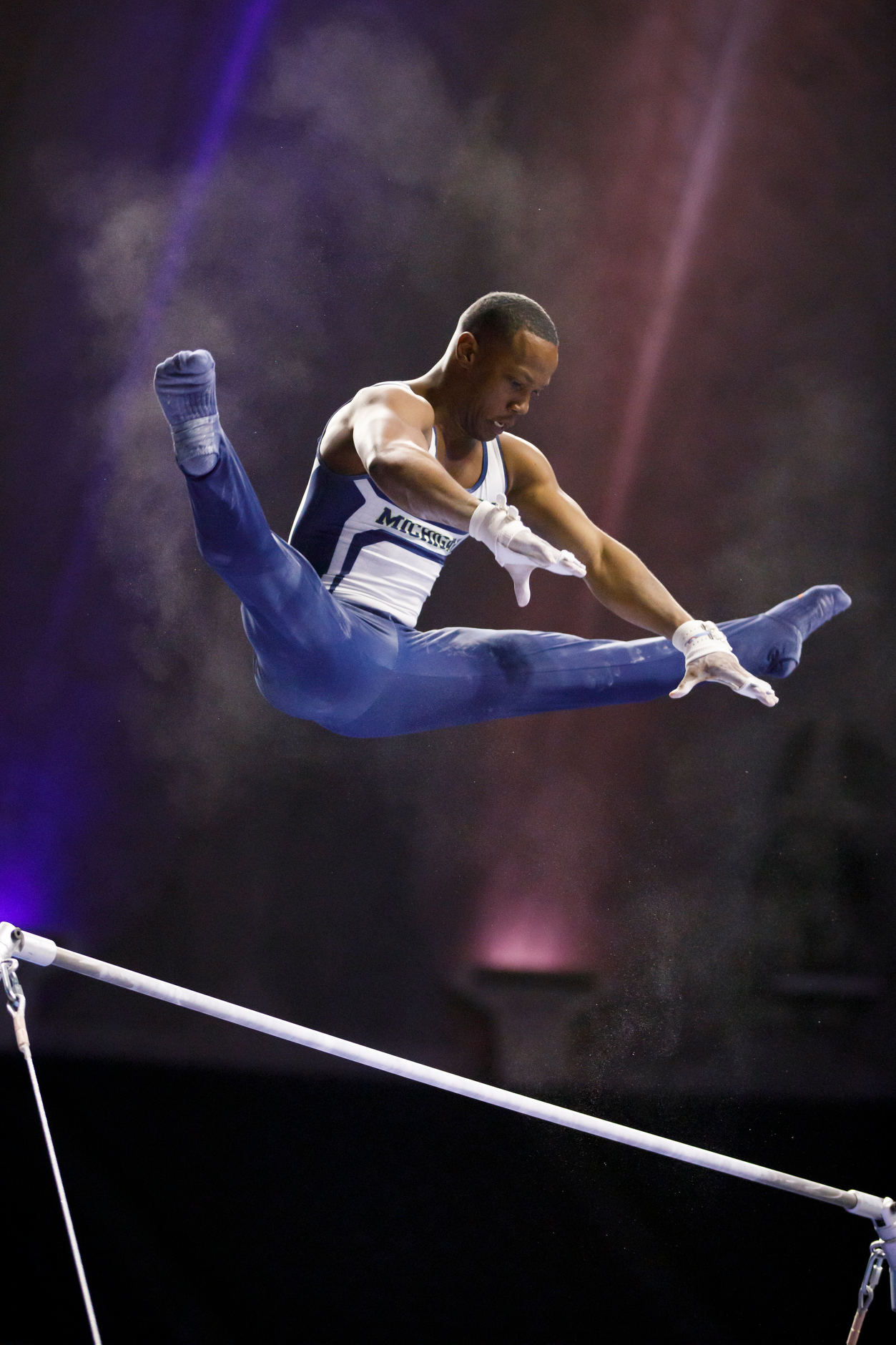 Michigan's Emyre Cole competes on the high bar at the NCAA Men's Gymnastics Championships on Friday, April 19, 2019, at the State Farm Center in Champaign, Illinois. (Photo by James Brosher)