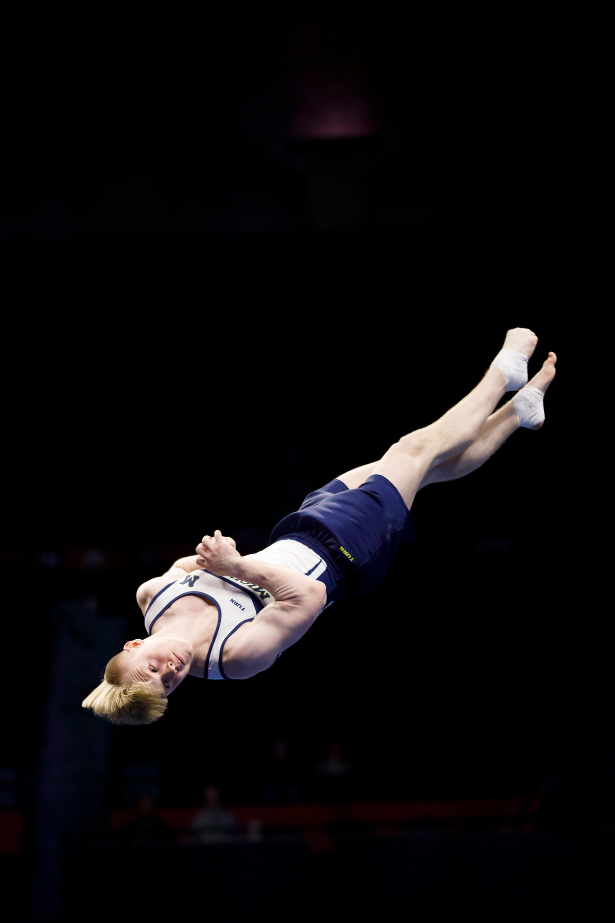 Michigan's Cameron Bock competes in the floor exercise at the NCAA Men's Gymnastics Championships on Friday, April 19, 2019, at the State Farm Center in Champaign, Illinois. (Photo by James Brosher)