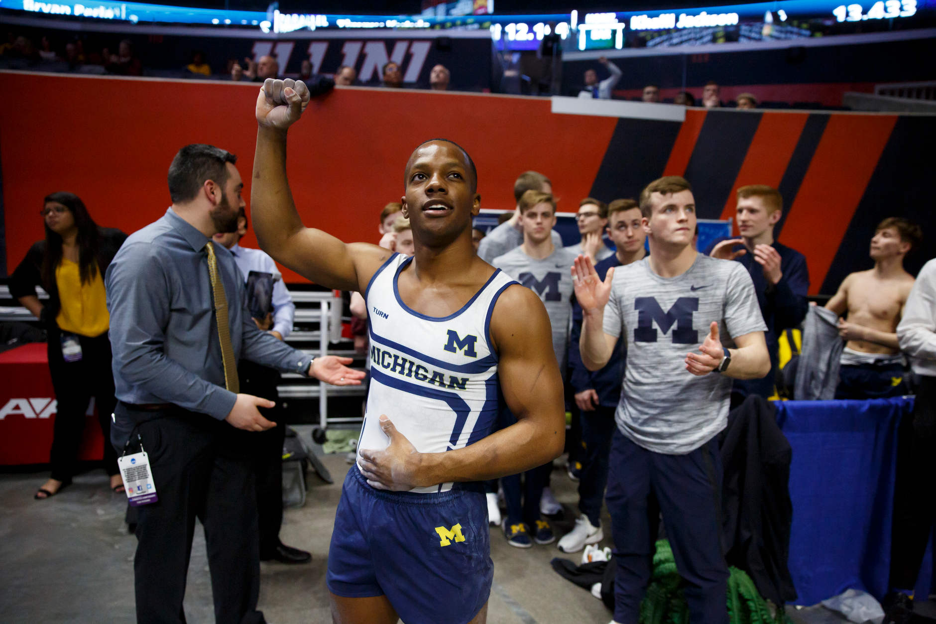 Michigan's Emyre Cole reacts to the team's score at the end of Session I at the NCAA Men's Gymnastics Championships on Friday, April 19, 2019, at the State Farm Center in Champaign, Illinois. (Photo by James Brosher)