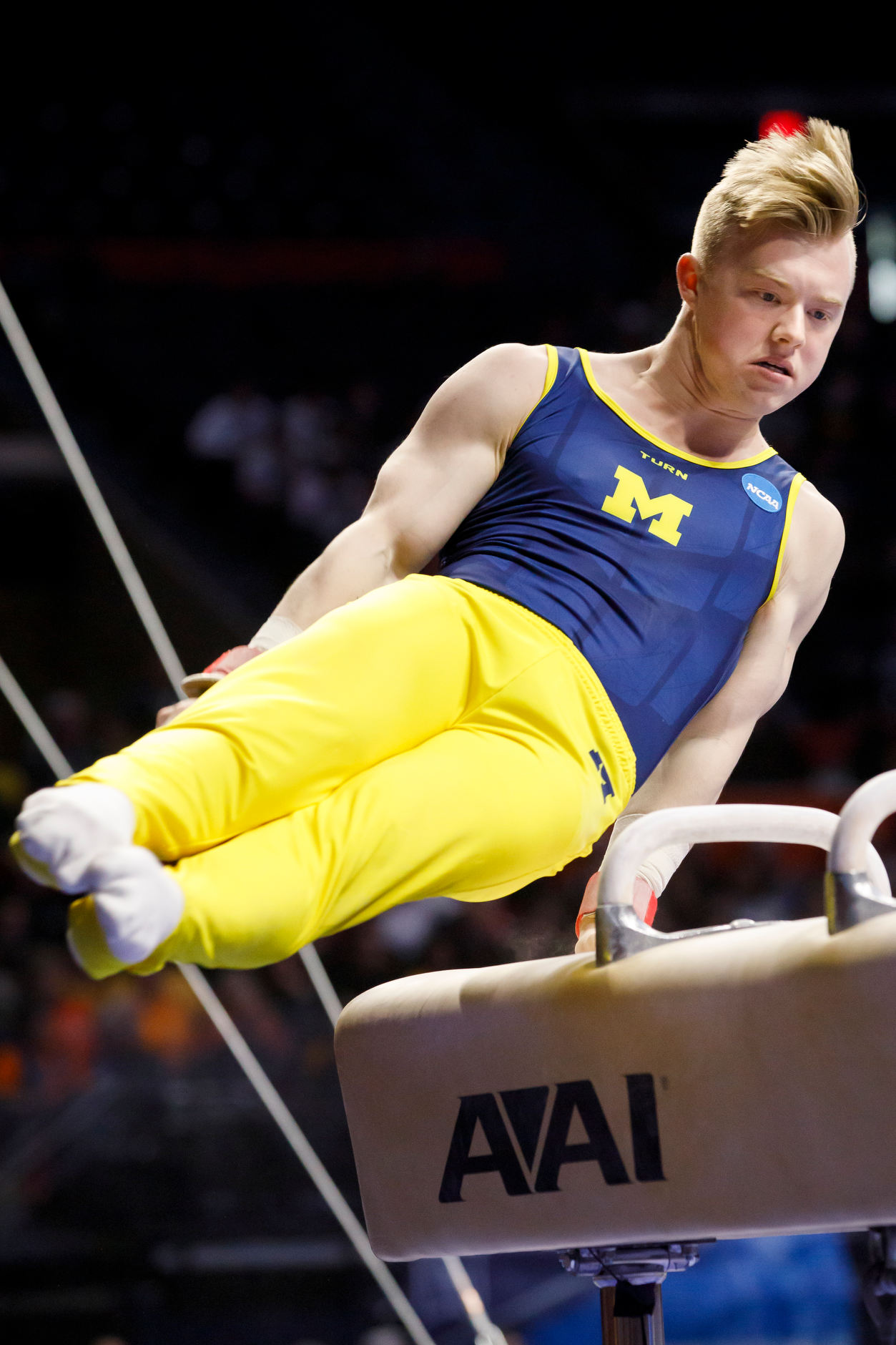 Michigan's Cameron Bock competes on the pommel horse at the NCAA Men's Gymnastics Championships on Saturday, April 20, 2019, at the State Farm Center in Champaign, Illinois. (Photo by James Brosher)