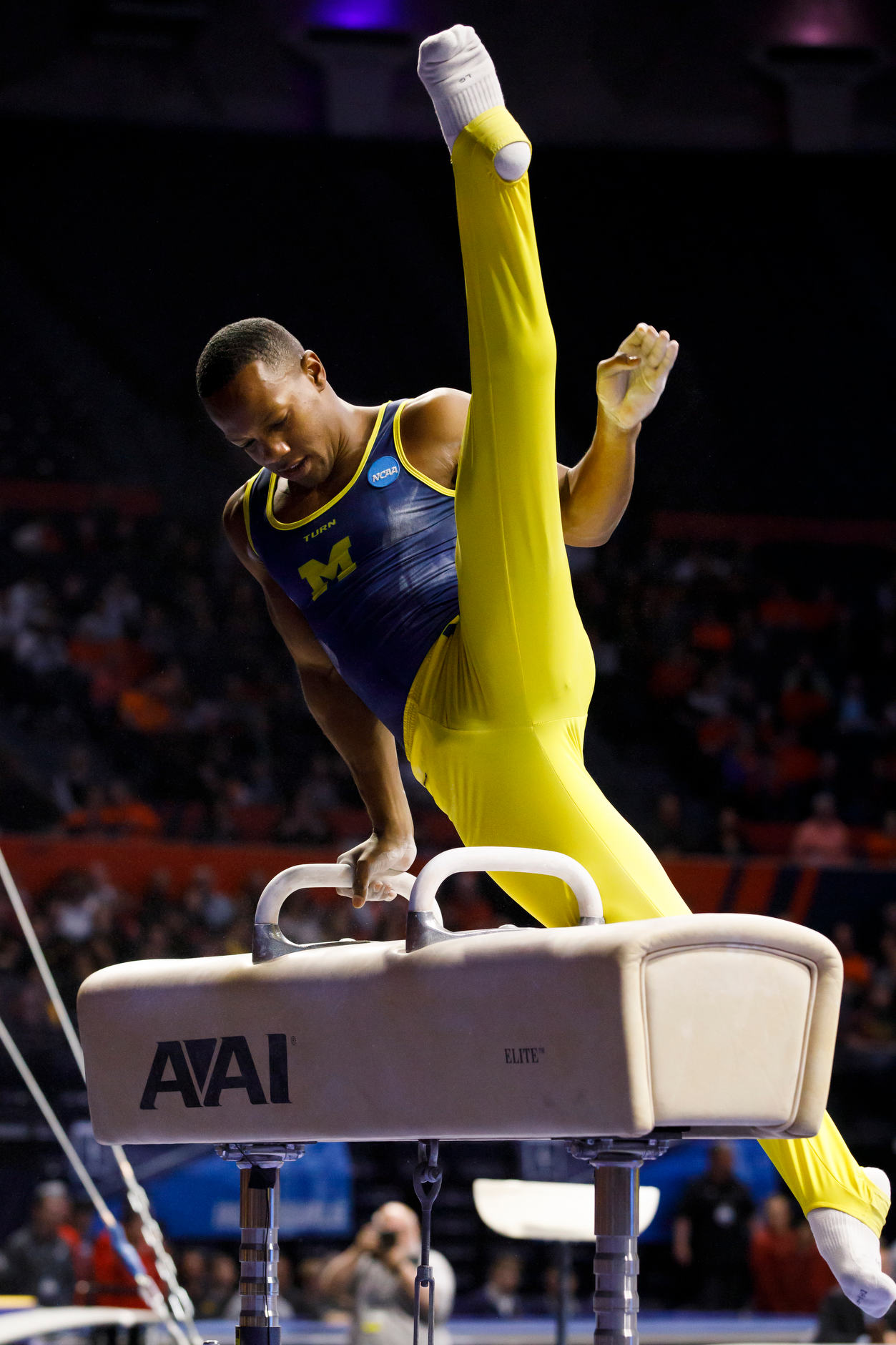 Michigan's Emyre Cole competes on the pommel horse at the NCAA Men's Gymnastics Championships on Saturday, April 20, 2019, at the State Farm Center in Champaign, Illinois. (Photo by James Brosher)