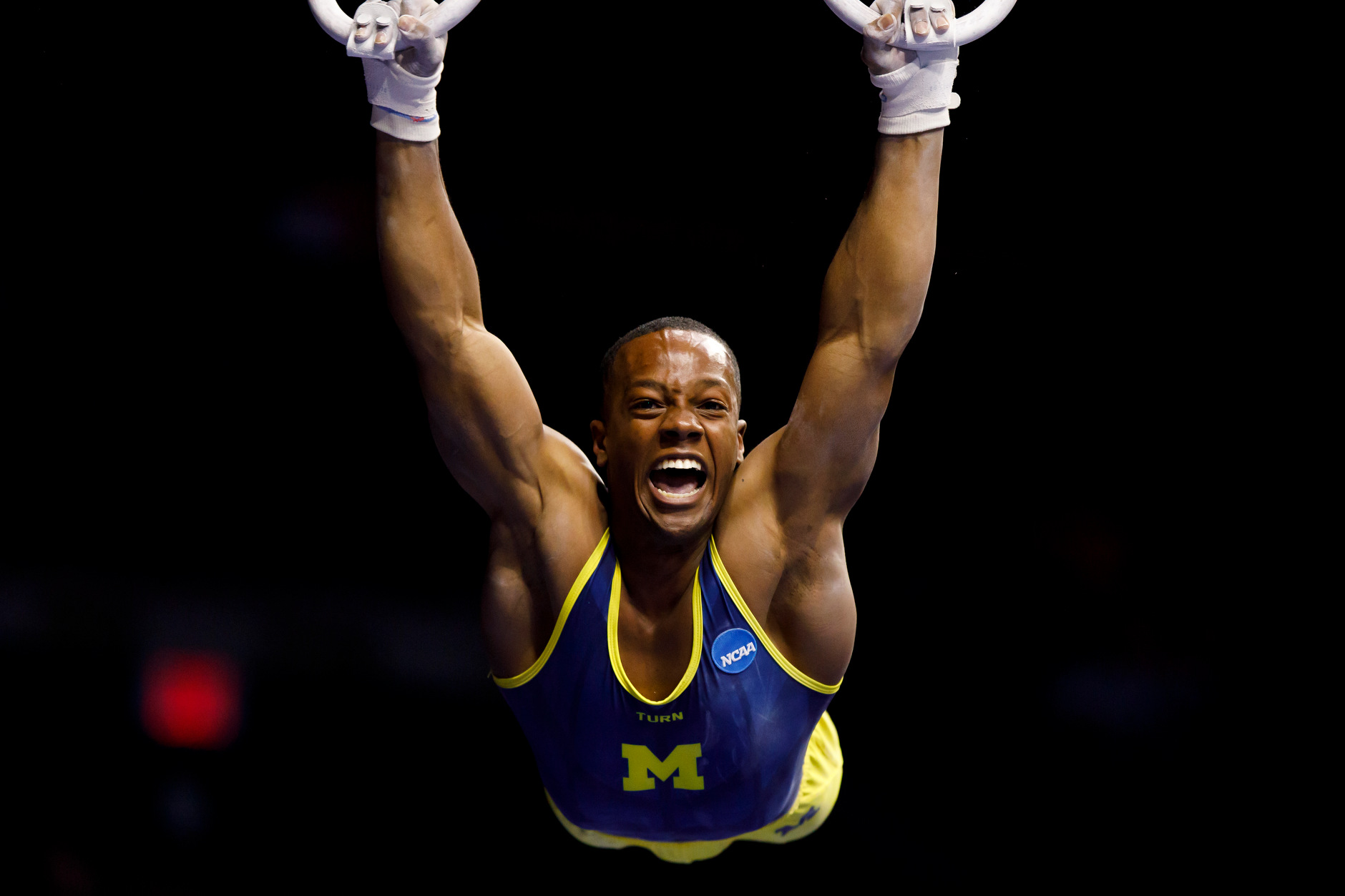 Michigan's Emyre Cole competes on the rings at the NCAA Men's Gymnastics Championships on Saturday, April 20, 2019, at the State Farm Center in Champaign, Illinois. (Photo by James Brosher)