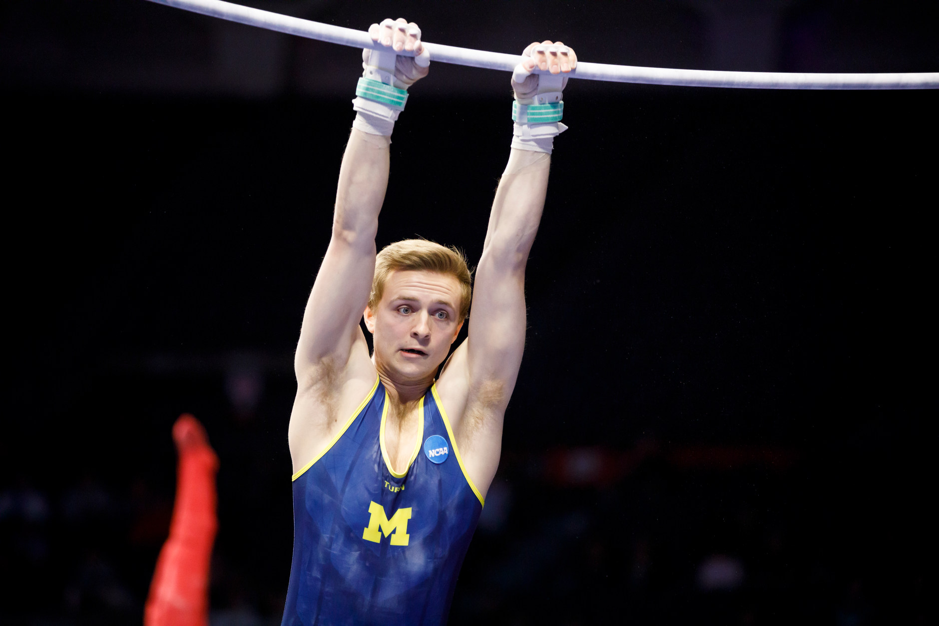 Michigan's Alec Krystek competes on the horizontal bar at the NCAA Men's Gymnastics Championships on Saturday, April 20, 2019, at the State Farm Center in Champaign, Illinois. (Photo by James Brosher)