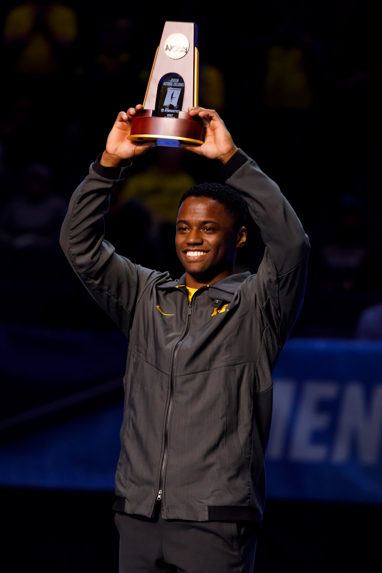 Michigan's Anthony McCallum poses for a photo after winning a national championship in the vault at the NCAA Men's Gymnastics Championships on Saturday, April 20, 2019, at the State Farm Center in Champaign, Illinois. (Photo by James Brosher)