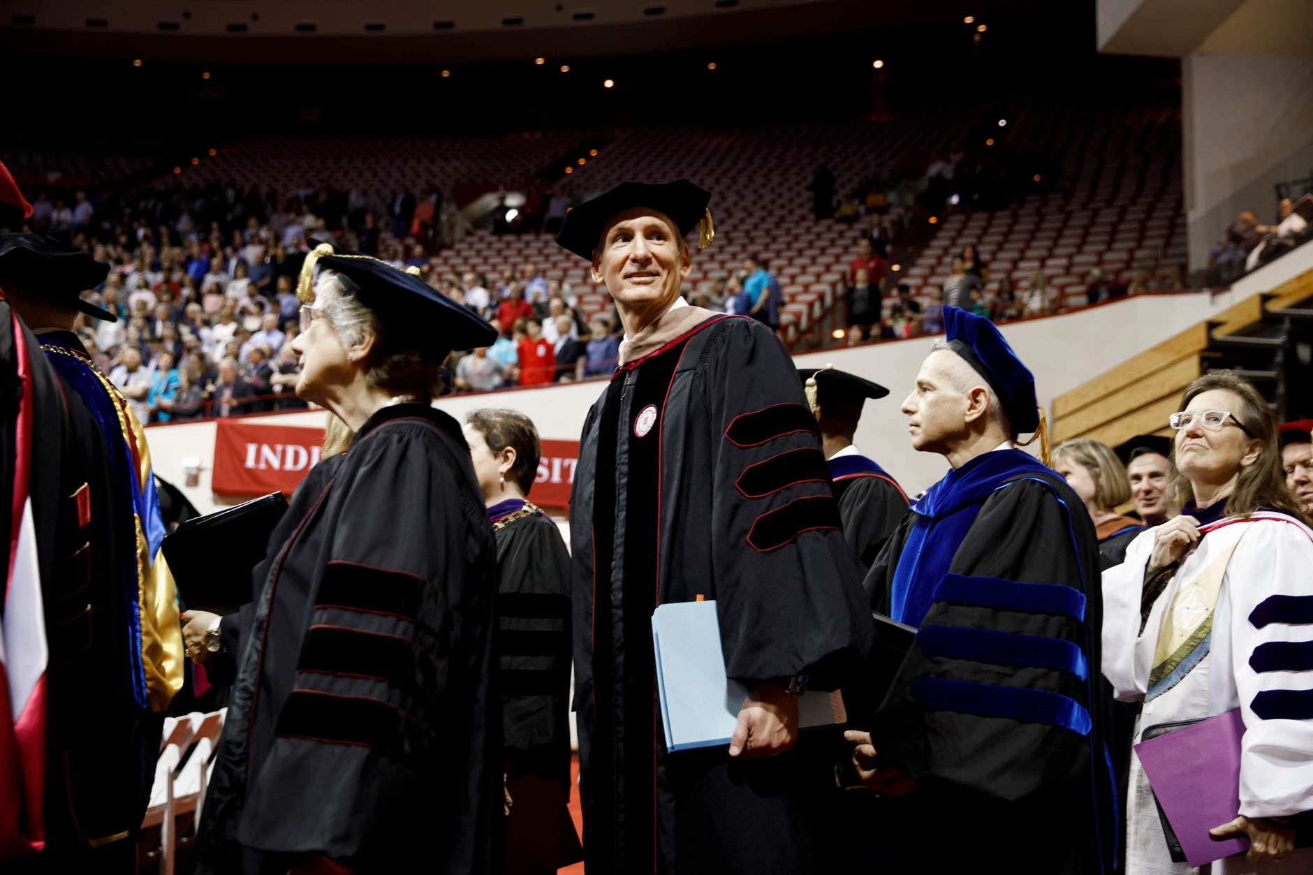 Cummins Chairman and CEO Tom Linebarger walks in the processional during the IU Bloomington Graduate Commencement at Assembly Hall on Friday, May 3, 2019. (James Brosher/Indiana University)