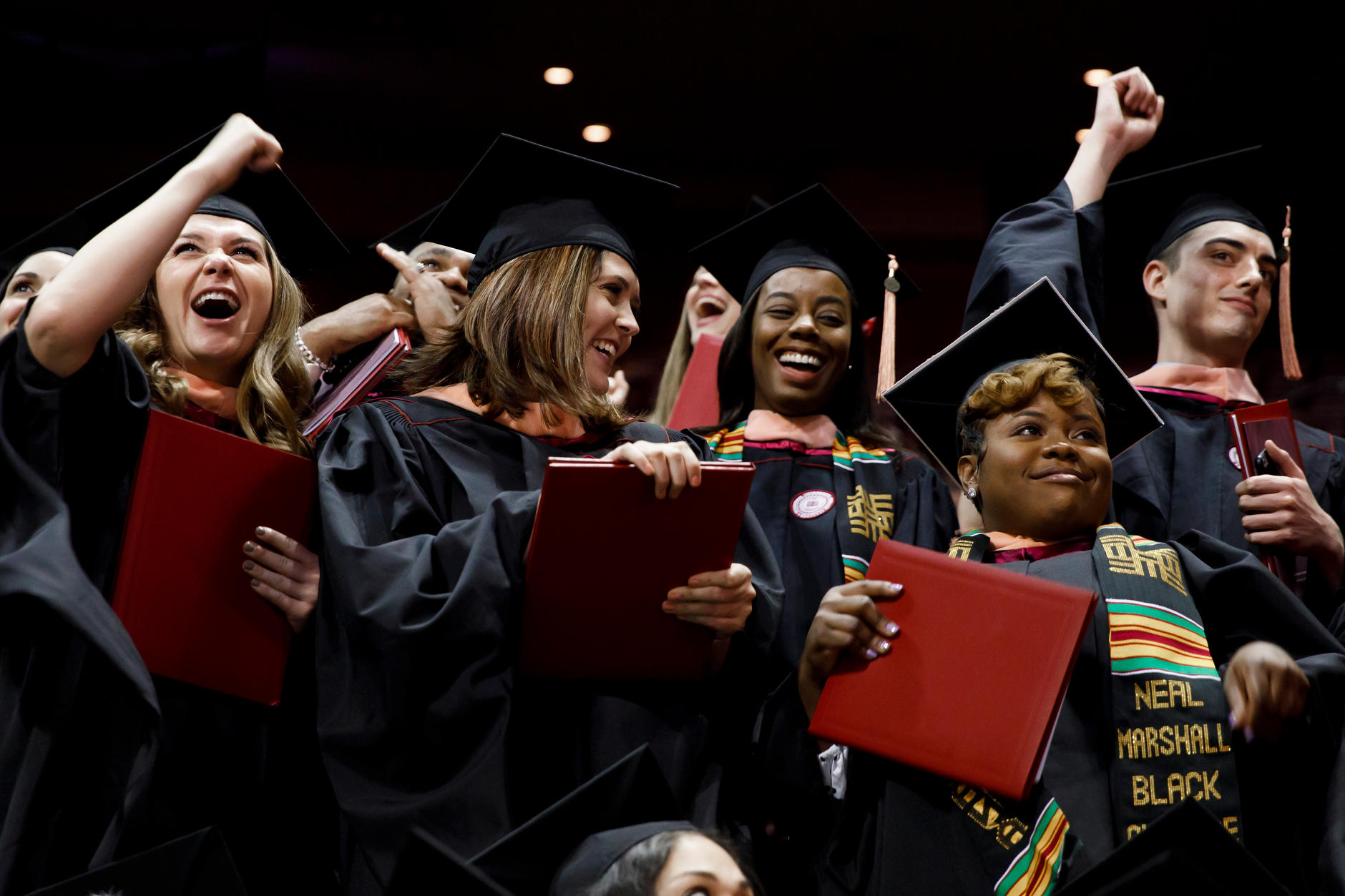 Graduates cheer during the Indiana University Bloomington Graduate Commencement at Assembly Hall on Friday, May 3, 2019. (James Brosher/Indiana University)