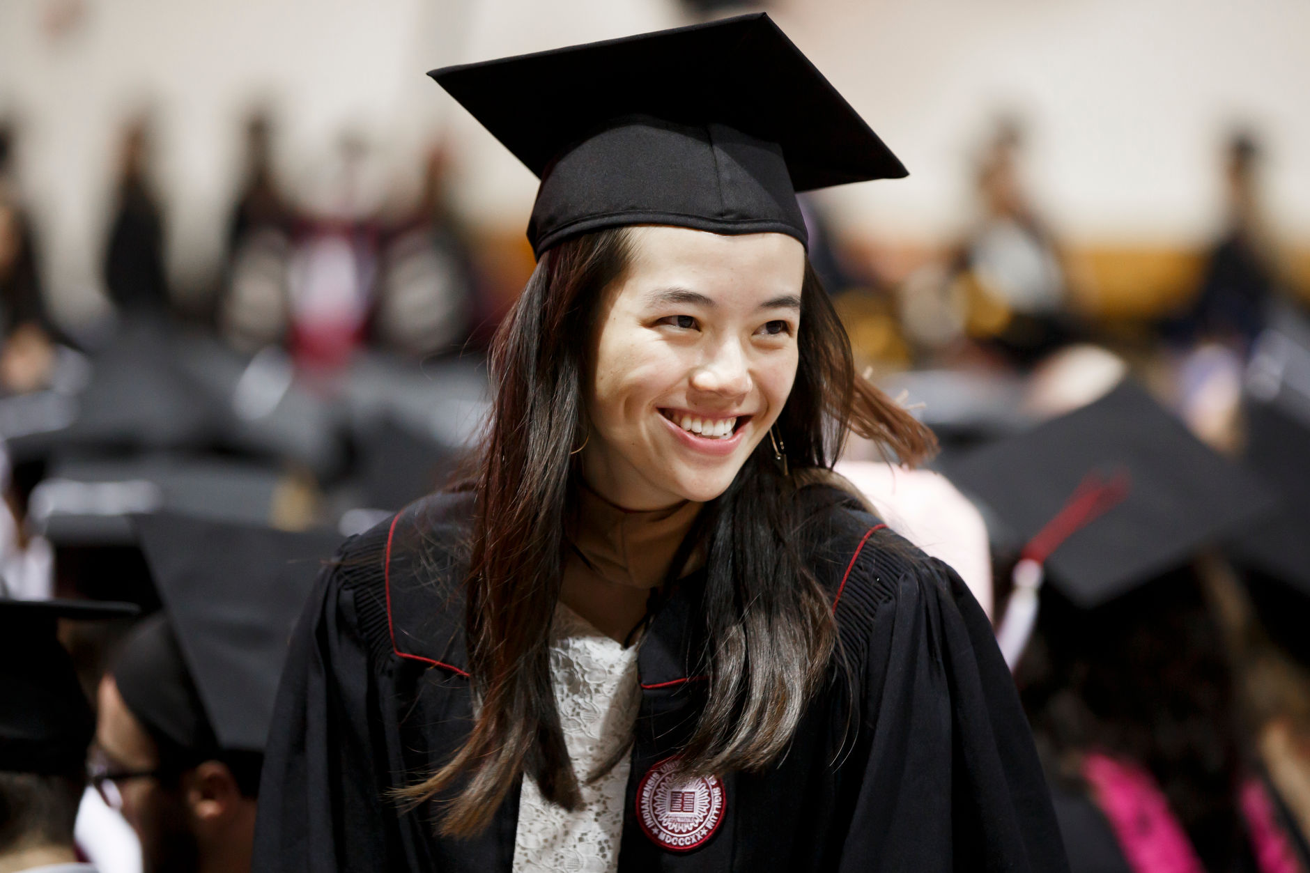 A graduate shares a smile during the Indiana University Bloomington Graduate Commencement at Assembly Hall on Friday, May 3, 2019. (James Brosher/Indiana University)