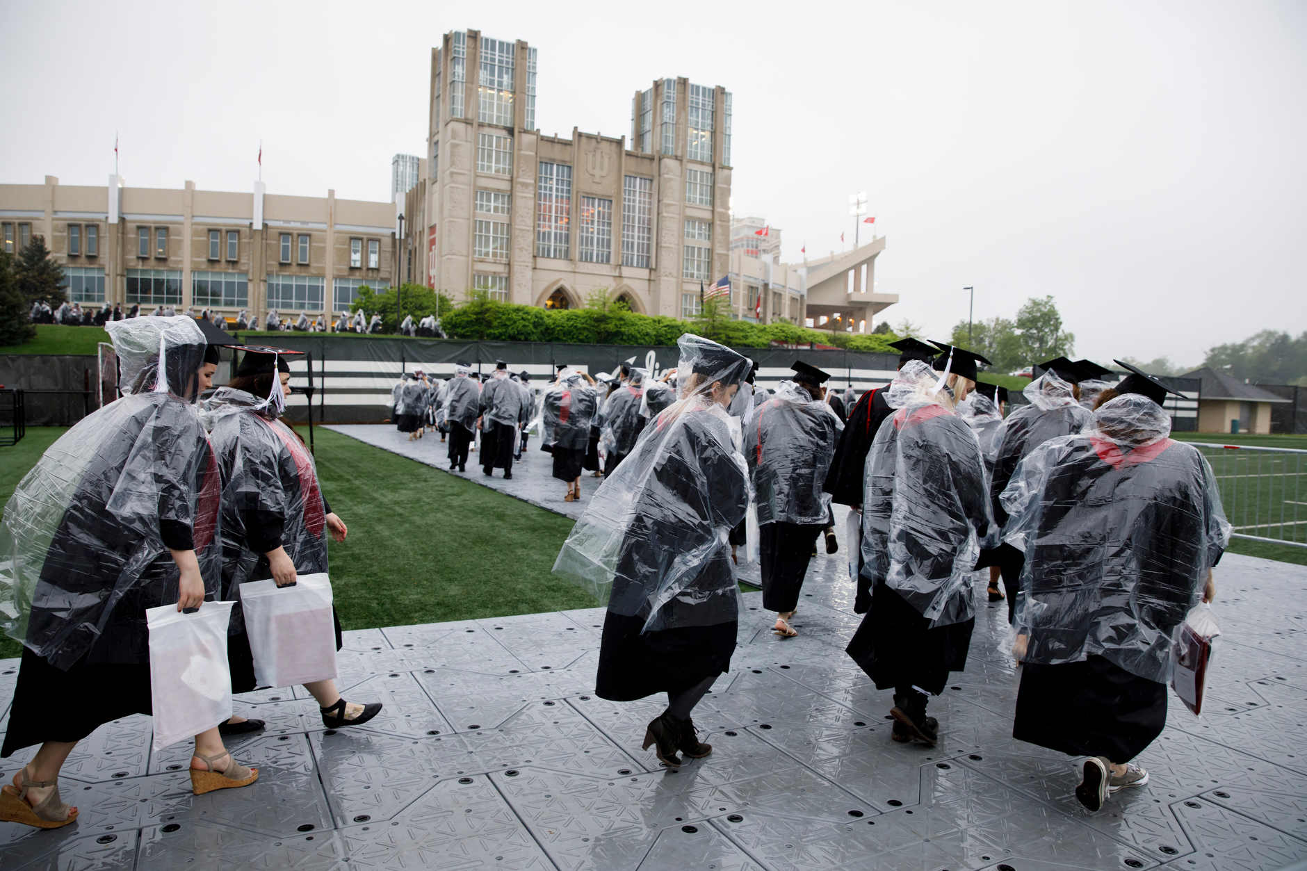 Graduates walk in the processional for the Indiana University Bloomington Undergraduate Commencement from Mellencamp Pavilion to Memorial Stadium on Saturday, May 4, 2019. (James Brosher/Indiana University)