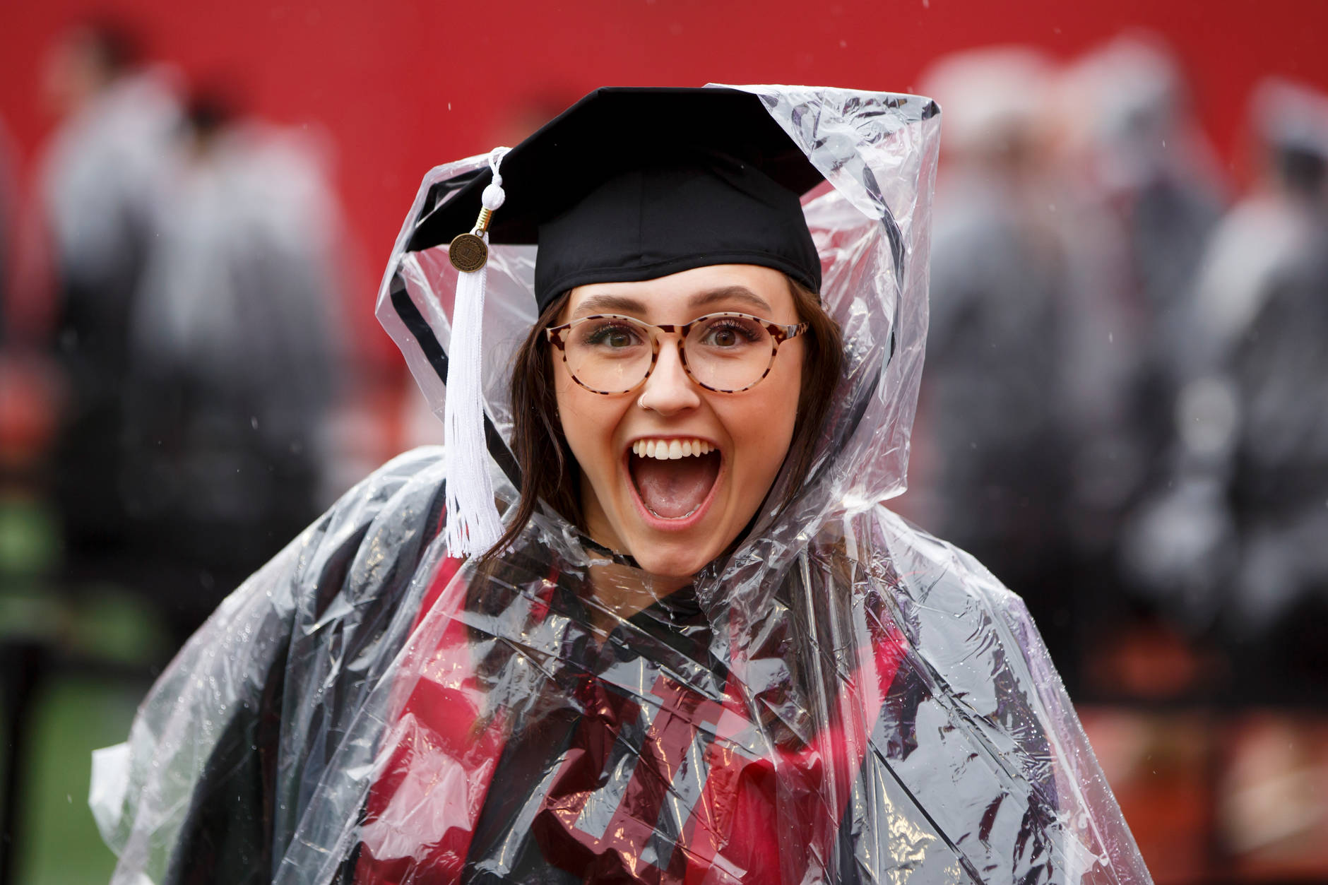 A graduates poses for a photo during the processional for the Indiana University Bloomington Undergraduate Commencement at Memorial Stadium on Saturday, May 4, 2019. (James Brosher/Indiana University)