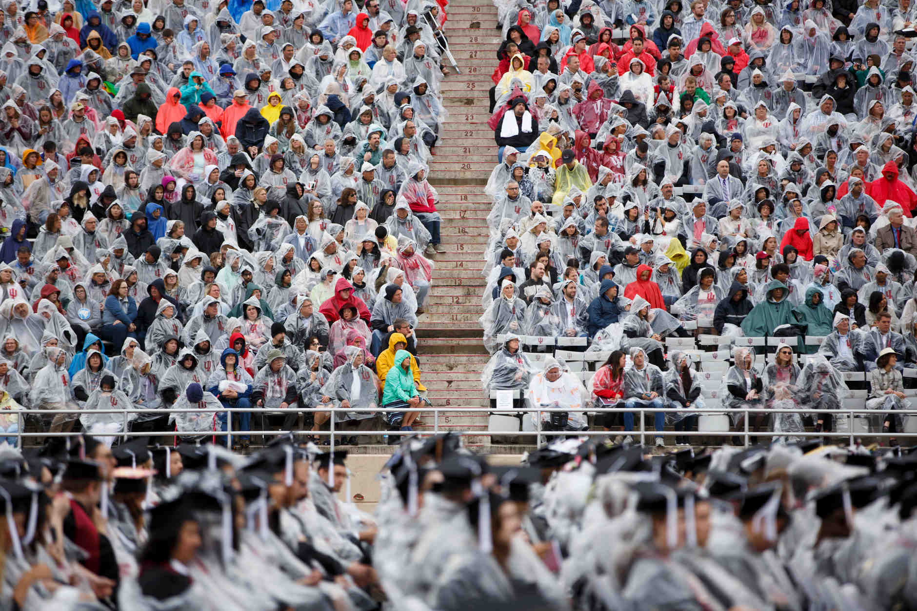 Audience members watch from the stands during the Indiana University Bloomington Undergraduate Commencement at Memorial Stadium on Saturday, May 4, 2019. (James Brosher/Indiana University)