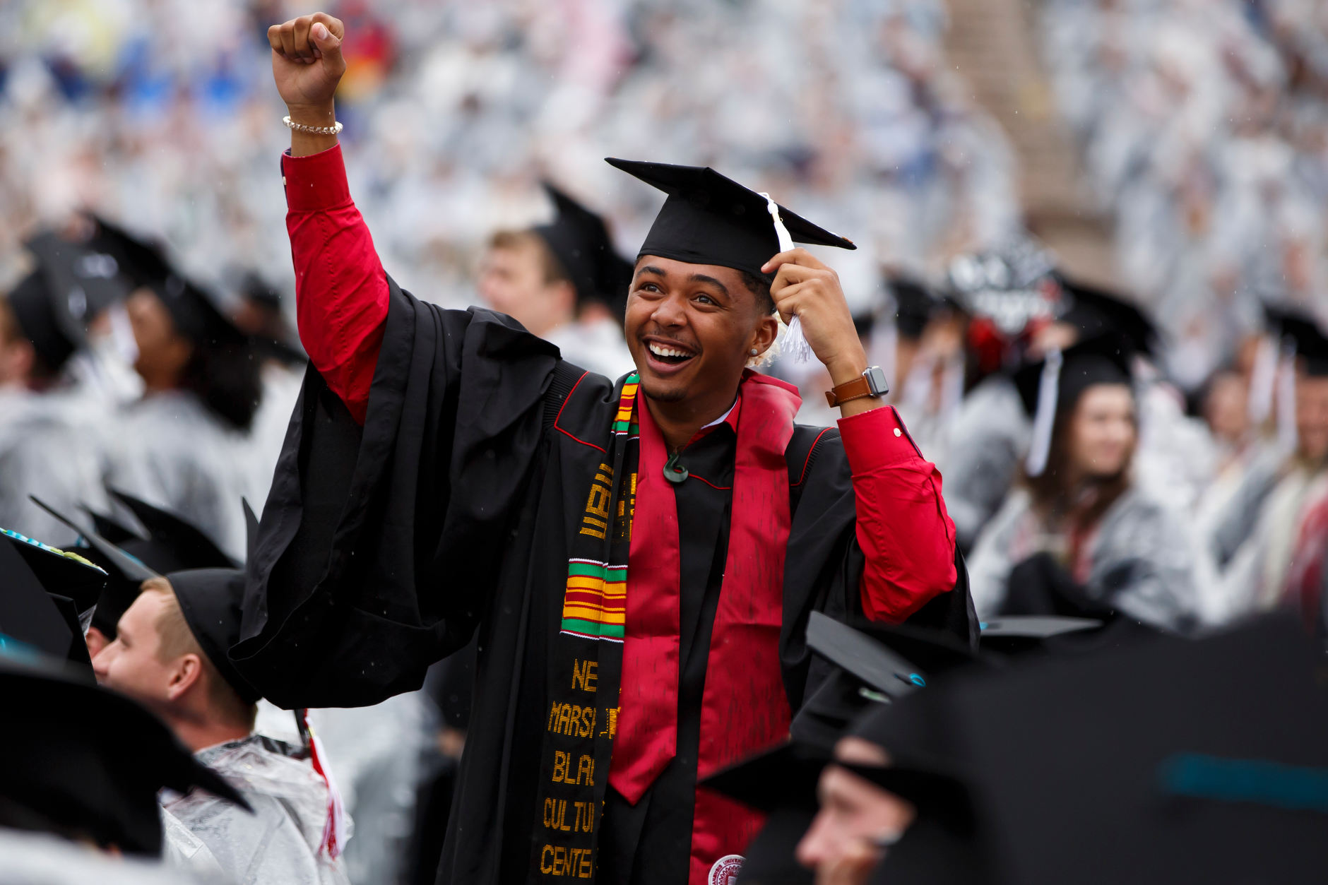 A graduate waves to friends in the audience during the Indiana University Bloomington Undergraduate Commencement at Memorial Stadium on Saturday, May 4, 2019. (James Brosher/Indiana University)