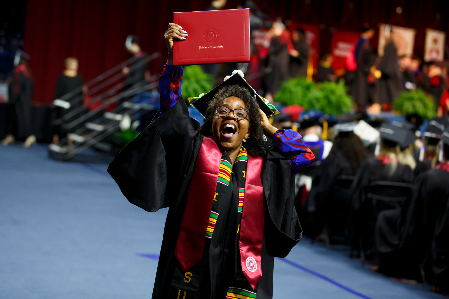 A graduate cheers after receiving her diploma at the Indiana University South Bend Commencement at the University of Notre Dame on Tuesday, May 7, 2019. (James Brosher/Indiana University)