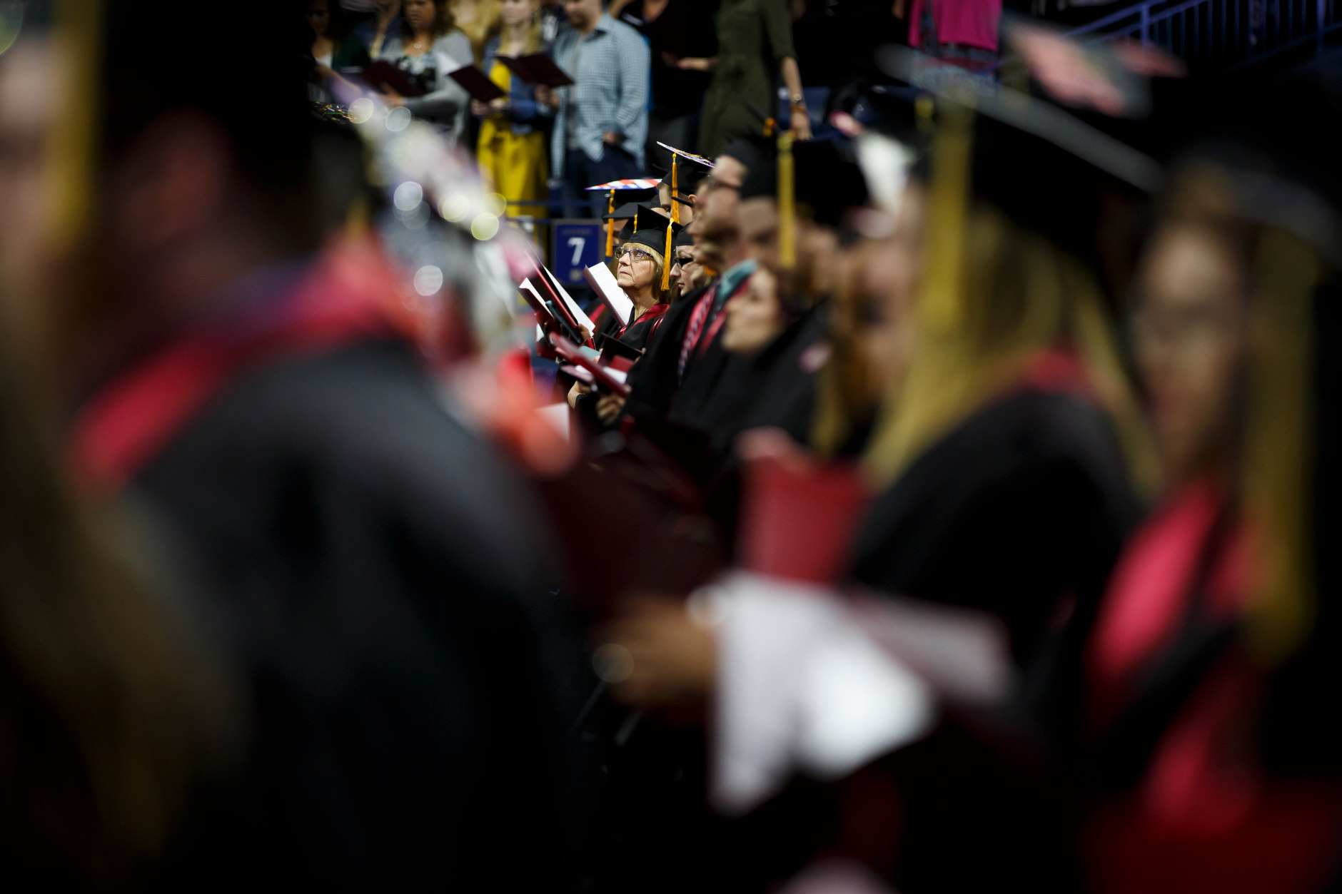 Graduates stand for the singing of the alma mater during the Indiana University South Bend Commencement at the University of Notre Dame on Tuesday, May 7, 2019. (James Brosher/Indiana University)