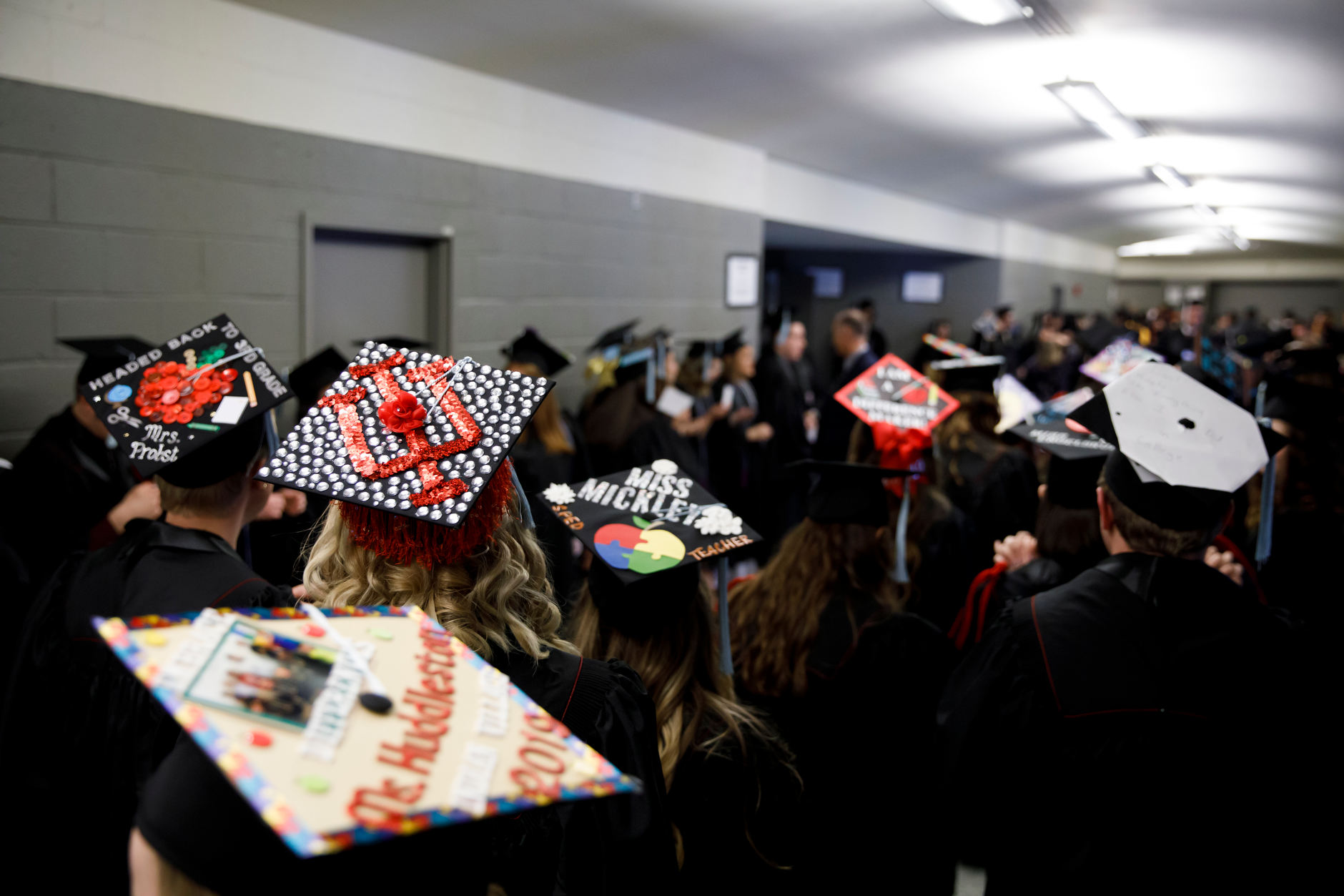 An Indiana University graduate wears a decorated mortarboard before the Purdue Fort Wayne and IU Fort Wayne Commencement at the Allen County War Memorial Coliseum on Wednesday, May 8, 2019. (James Brosher/Indiana University)