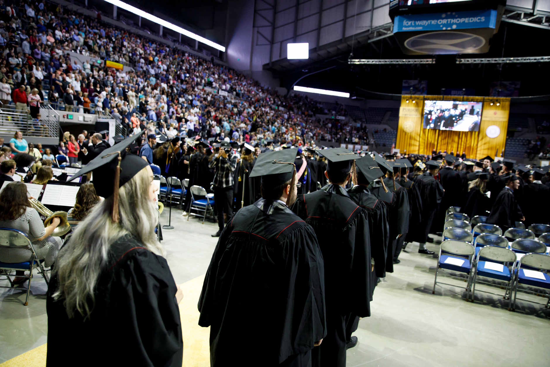 Graduates walk in the processional during the Purdue Fort Wayne and IU Fort Wayne Commencement at the Allen County War Memorial Coliseum on Wednesday, May 8, 2019. (James Brosher/Indiana University)