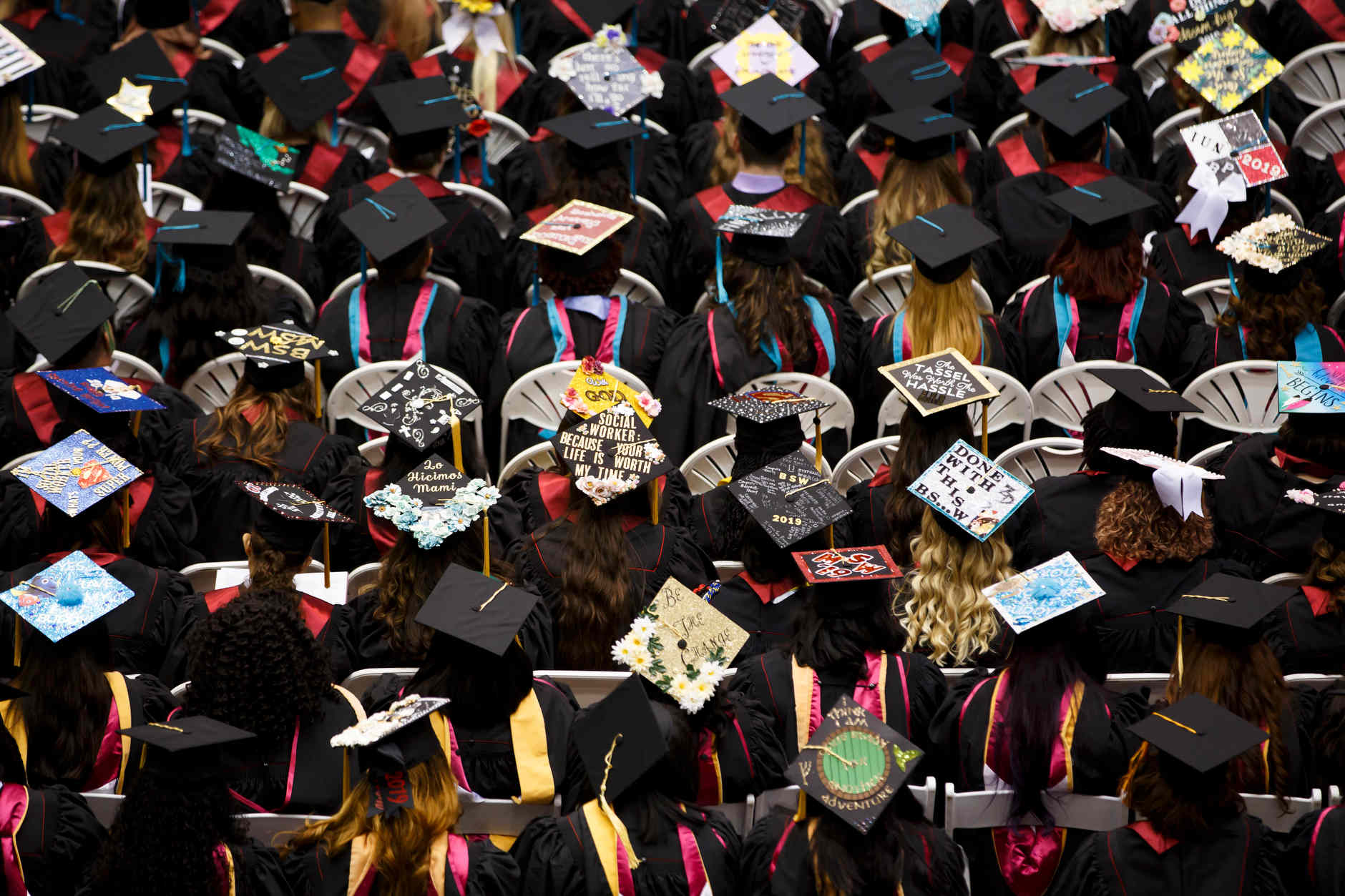 Graduates wear decorated mortarboards during the IU Northwest Commencement at the Genesis Convention Center on Thursday, May 9, 2019.